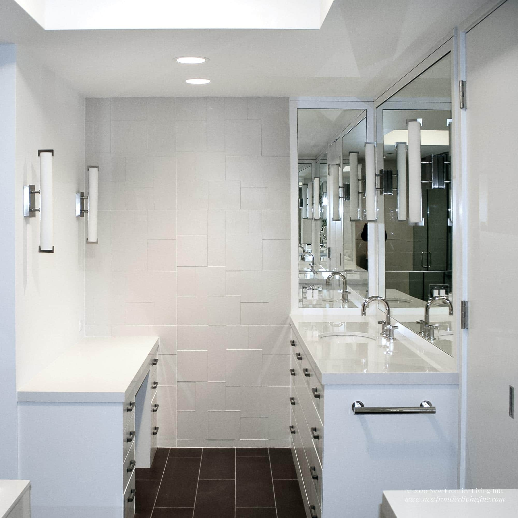 White bathroom installed by NFL Inc. square pic two mirrors and vanities shown