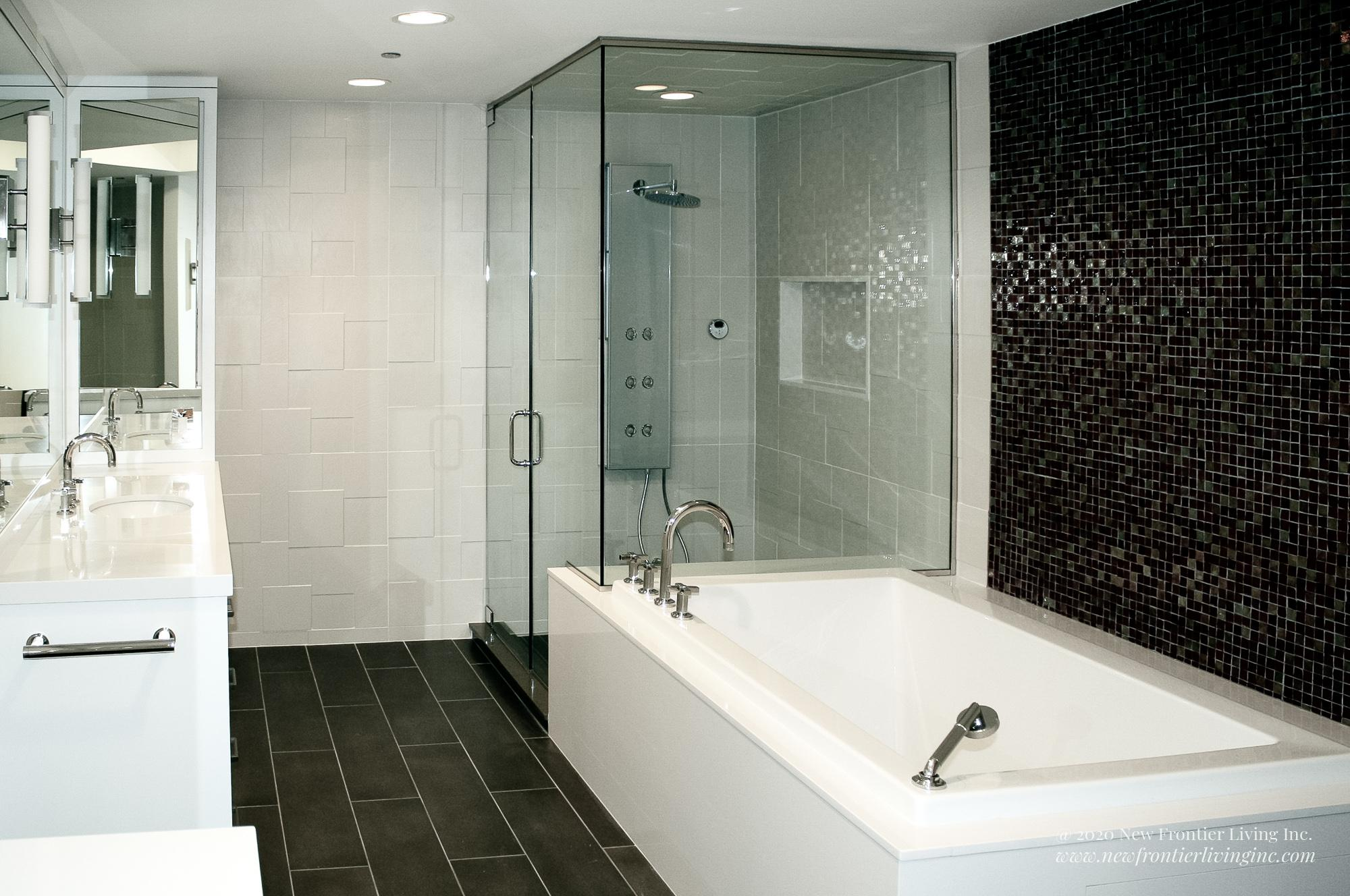 White bathroom installed by NFL Inc. shower and tub view