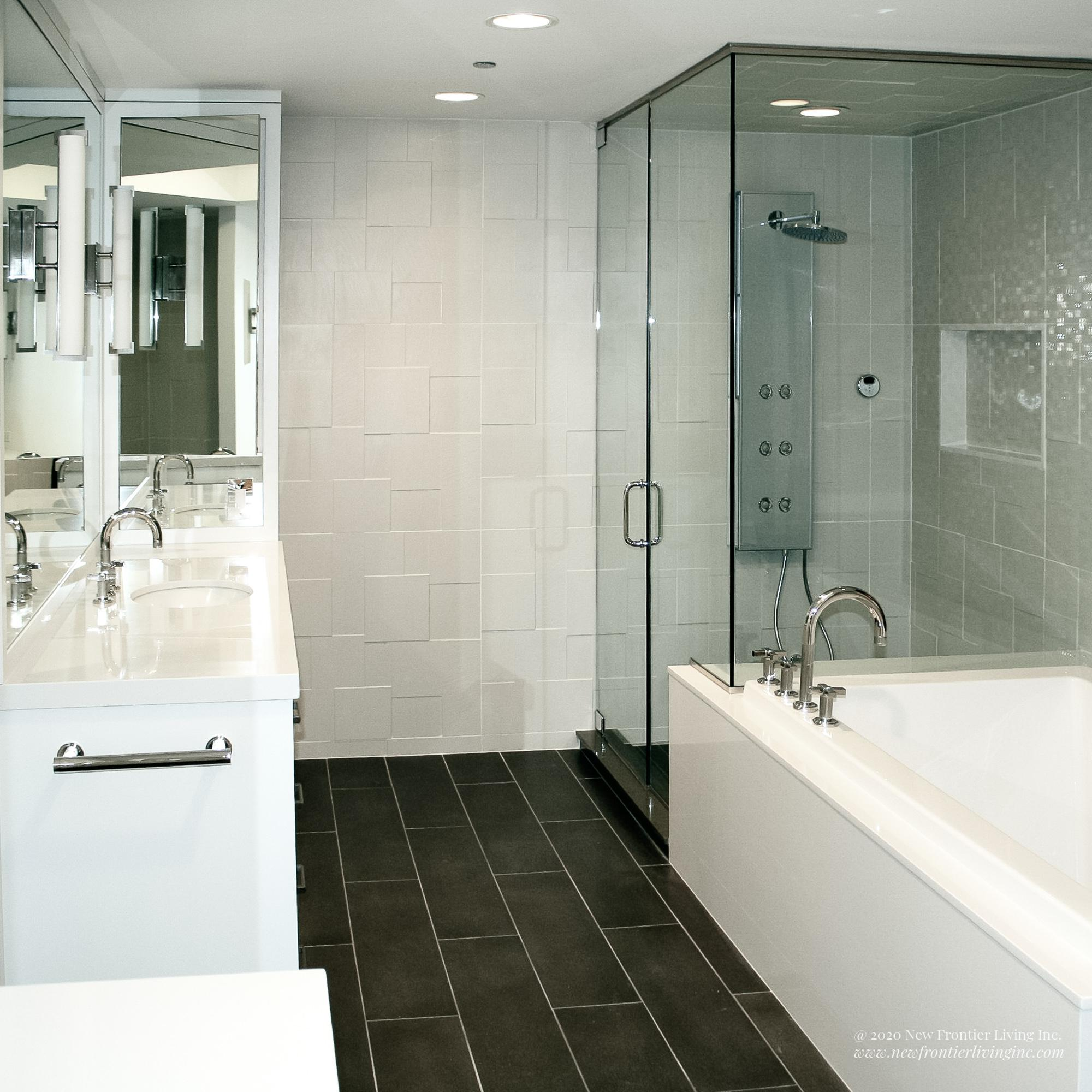 White bathroom installed by NFL Inc. mirror and vanity with shower and tub
