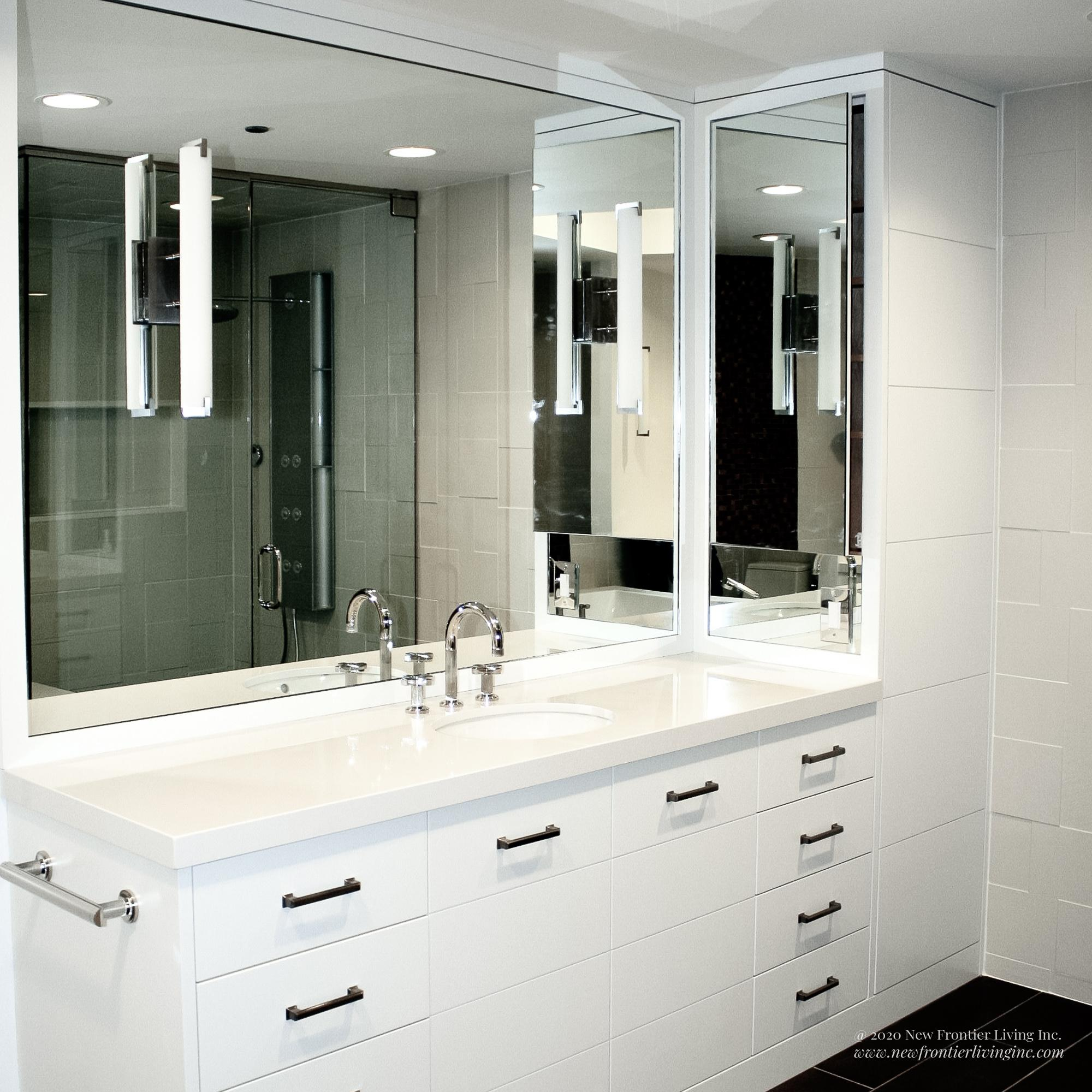 White bathroom installed by NFL Inc. mirror and vanity with sink view