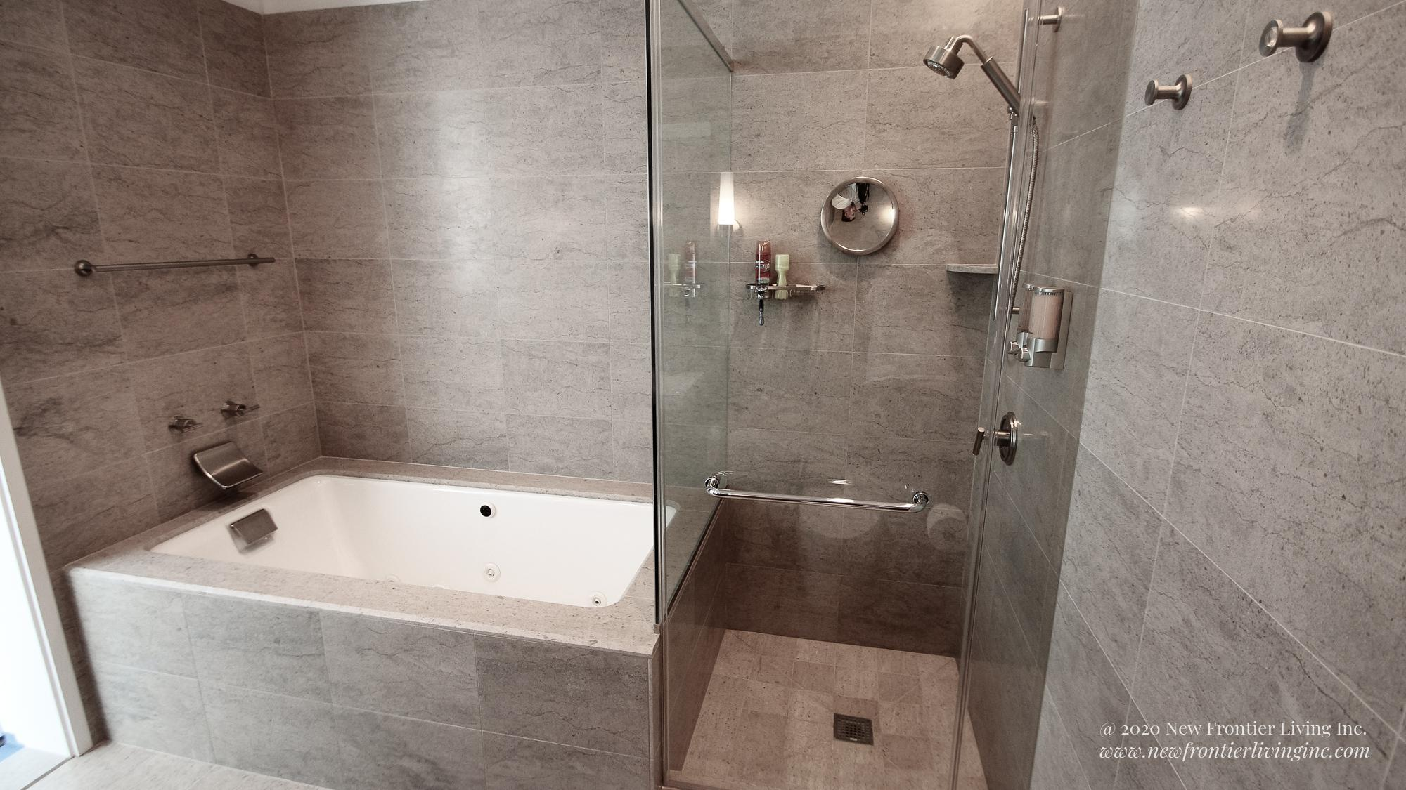Cream brown bathroom installed by NFL Inc. a walk-in shower and tub on the left