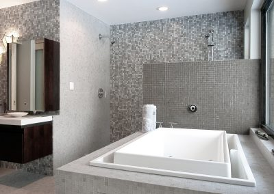 White and gray all ceramic bathroom with a tub and sink