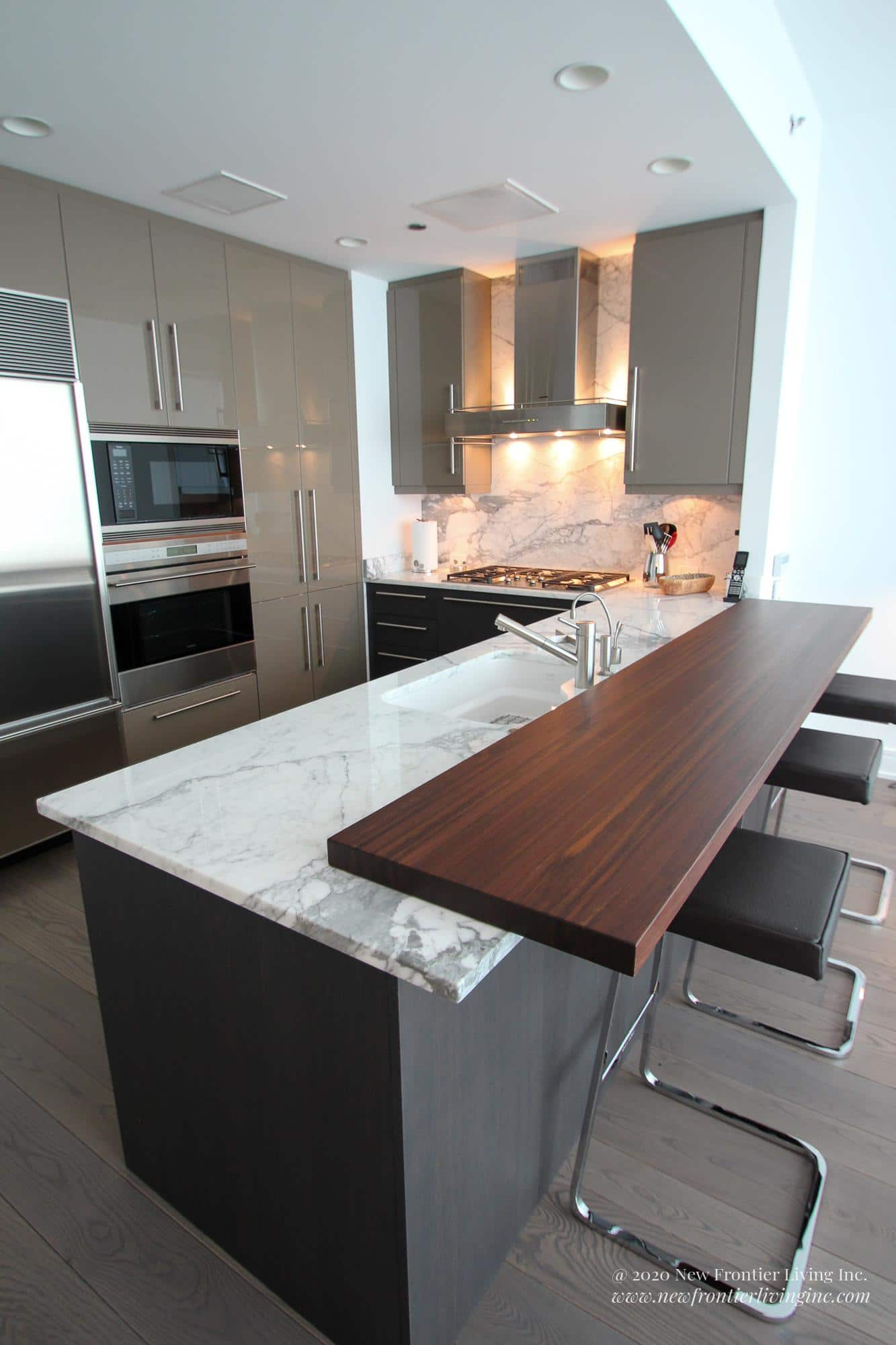 Dark gray kitchen with white granite counter, flip view