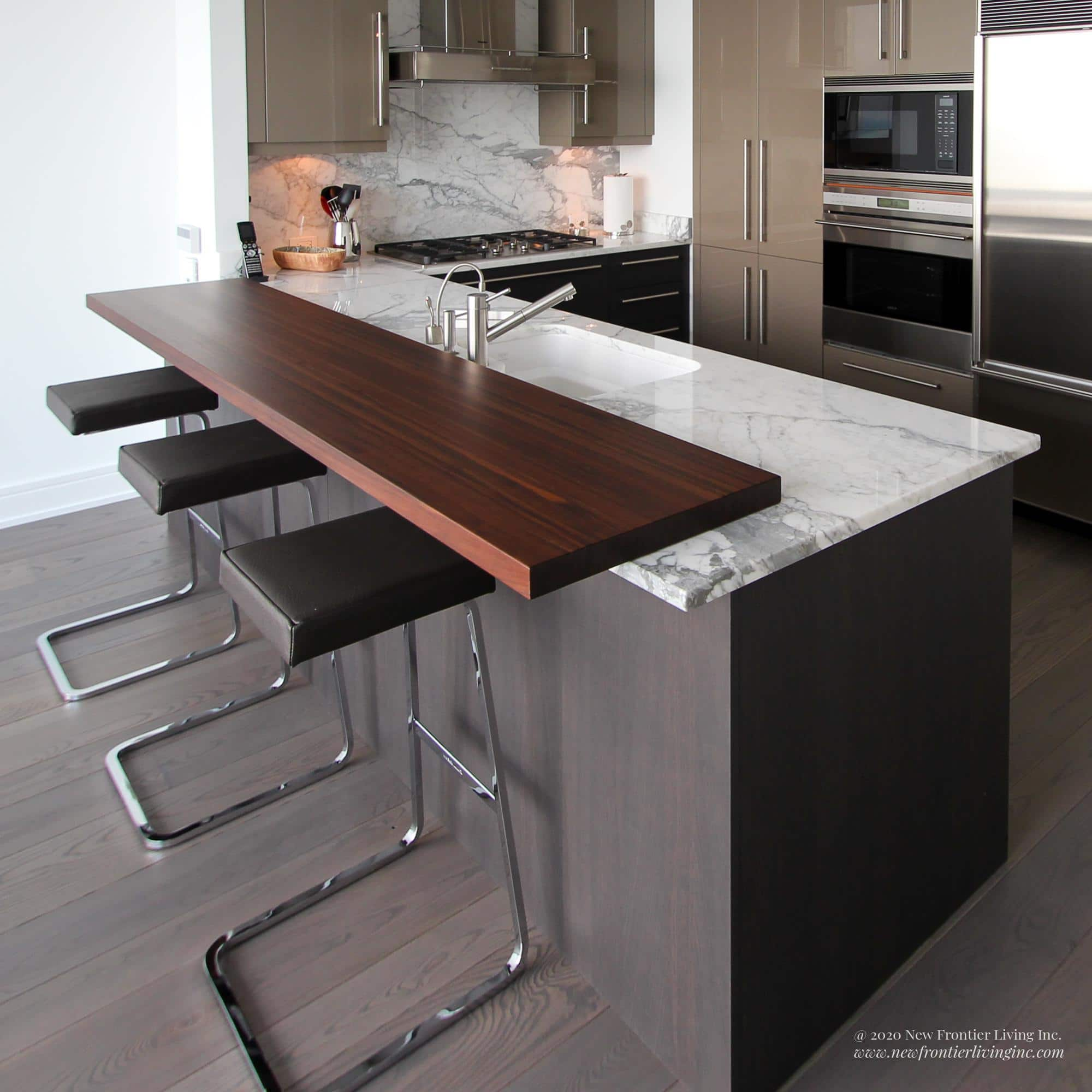 Dark gray kitchen with white granite countertop and brown extended wooden ledge