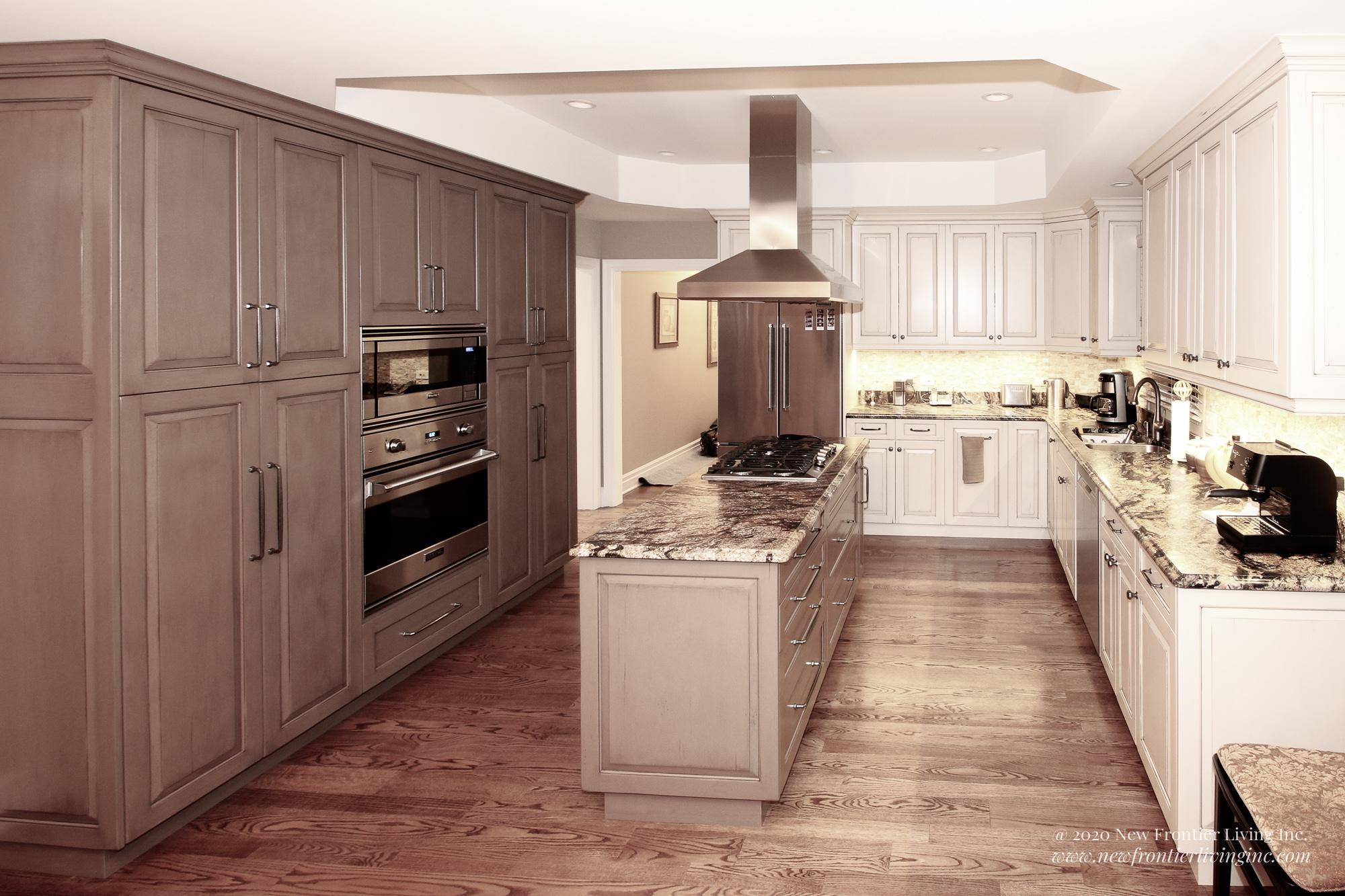 Custom light brown kitchen with island and cabinets, left side dark brown, right side light brown