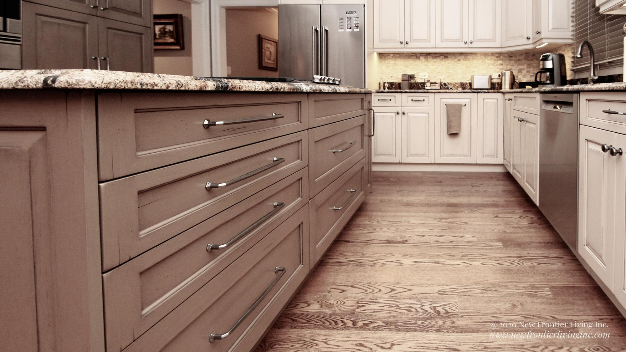 Custom light brown kitchen with island and cabinets