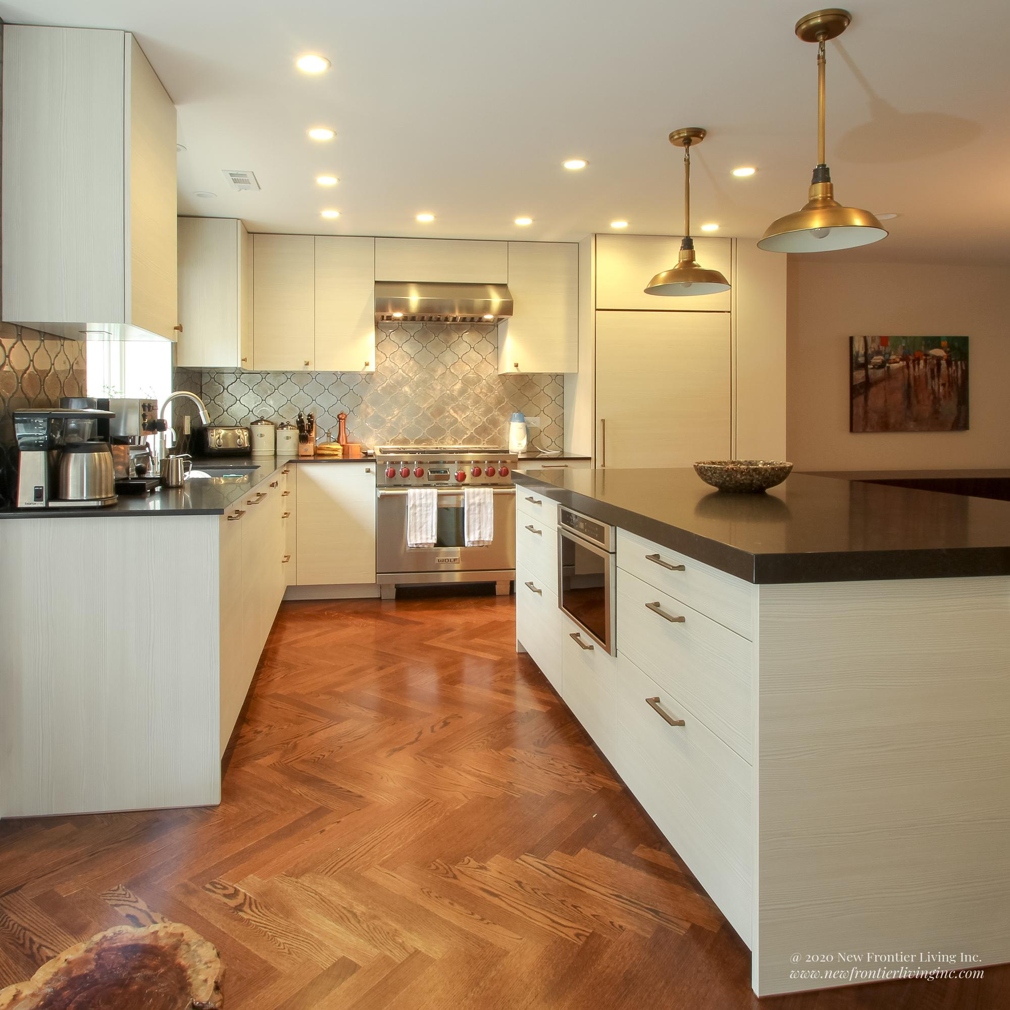 Cream kitchen with black countertops with an island