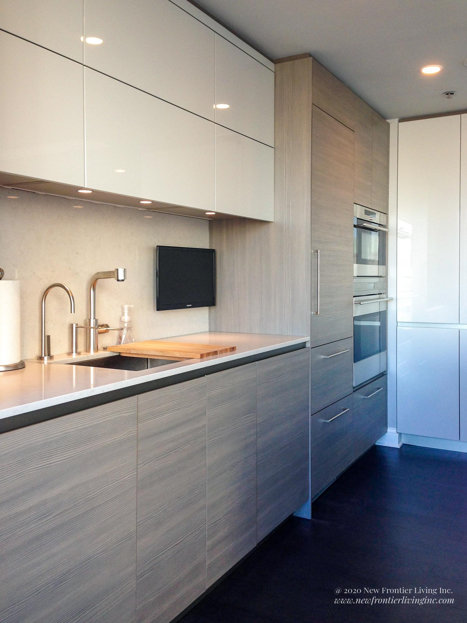 Light wood kitchen cabinetry with limited silver handles