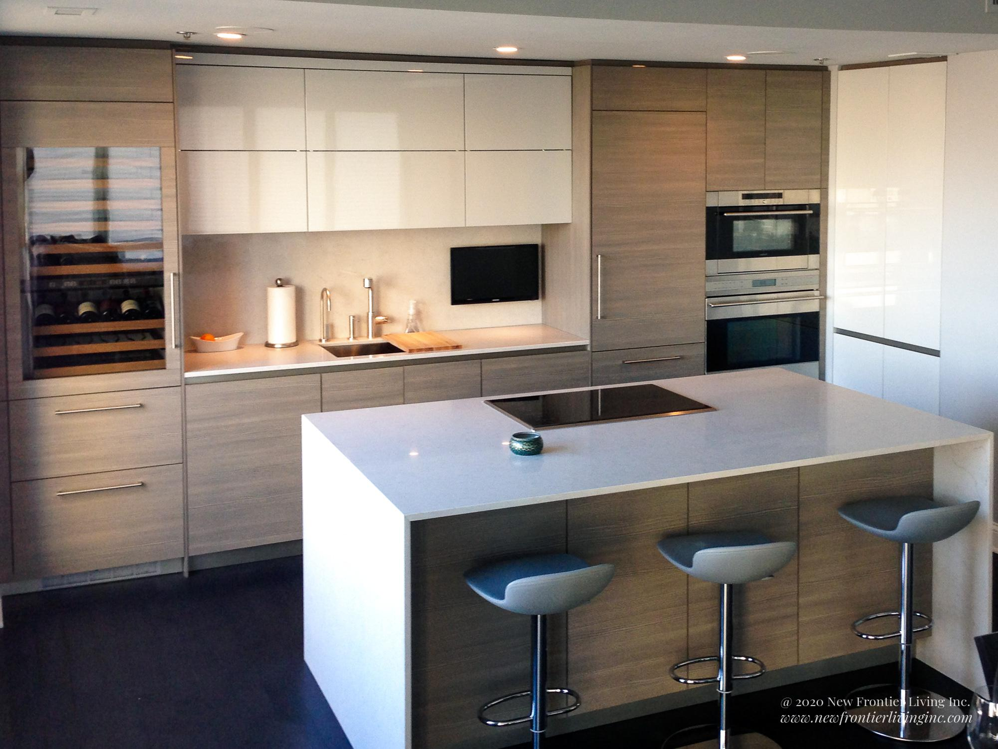 Light wood kitchen with a waterfall island with white countertop