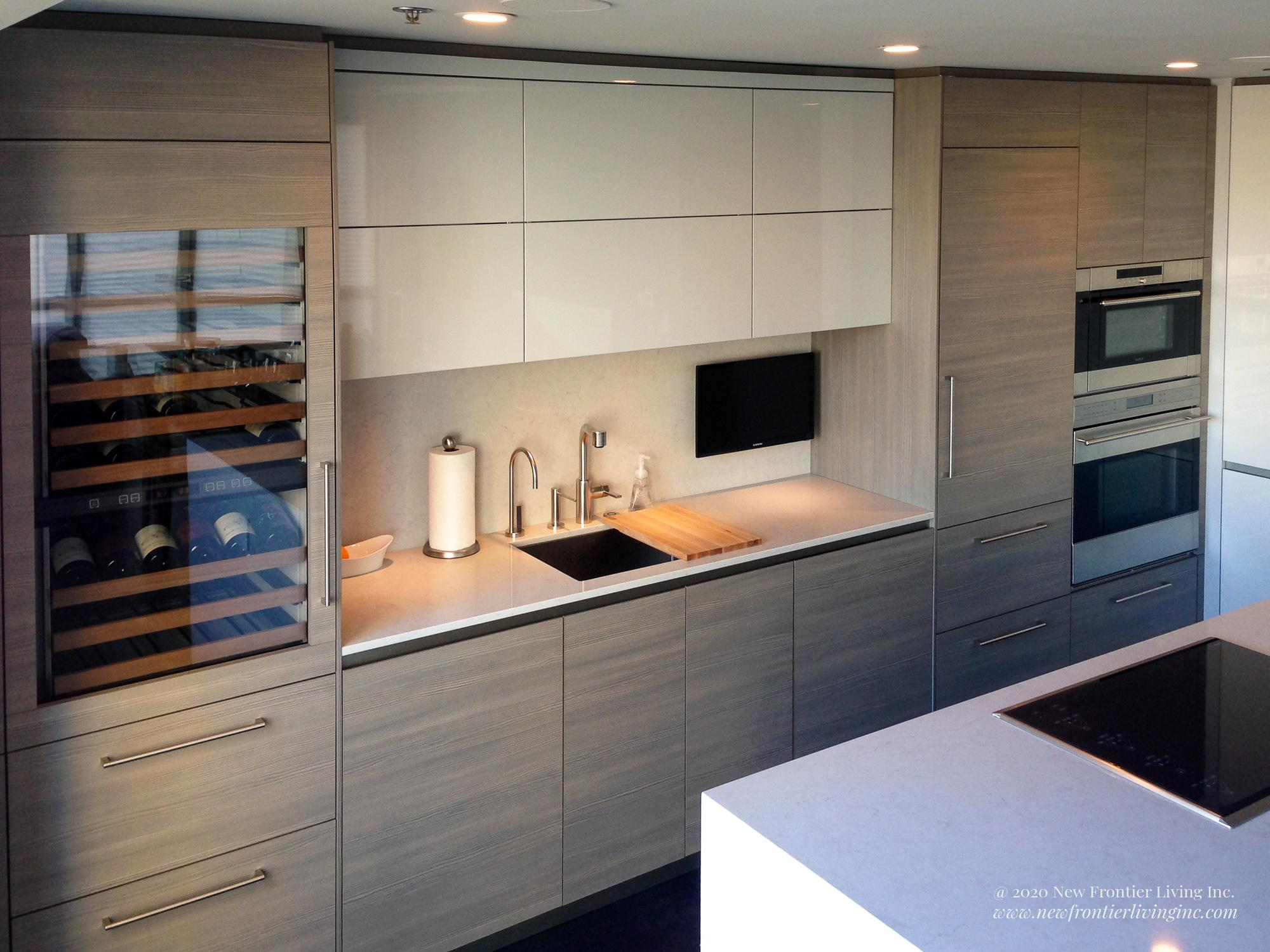 Light wood kitchen cabinetry with wine cooler