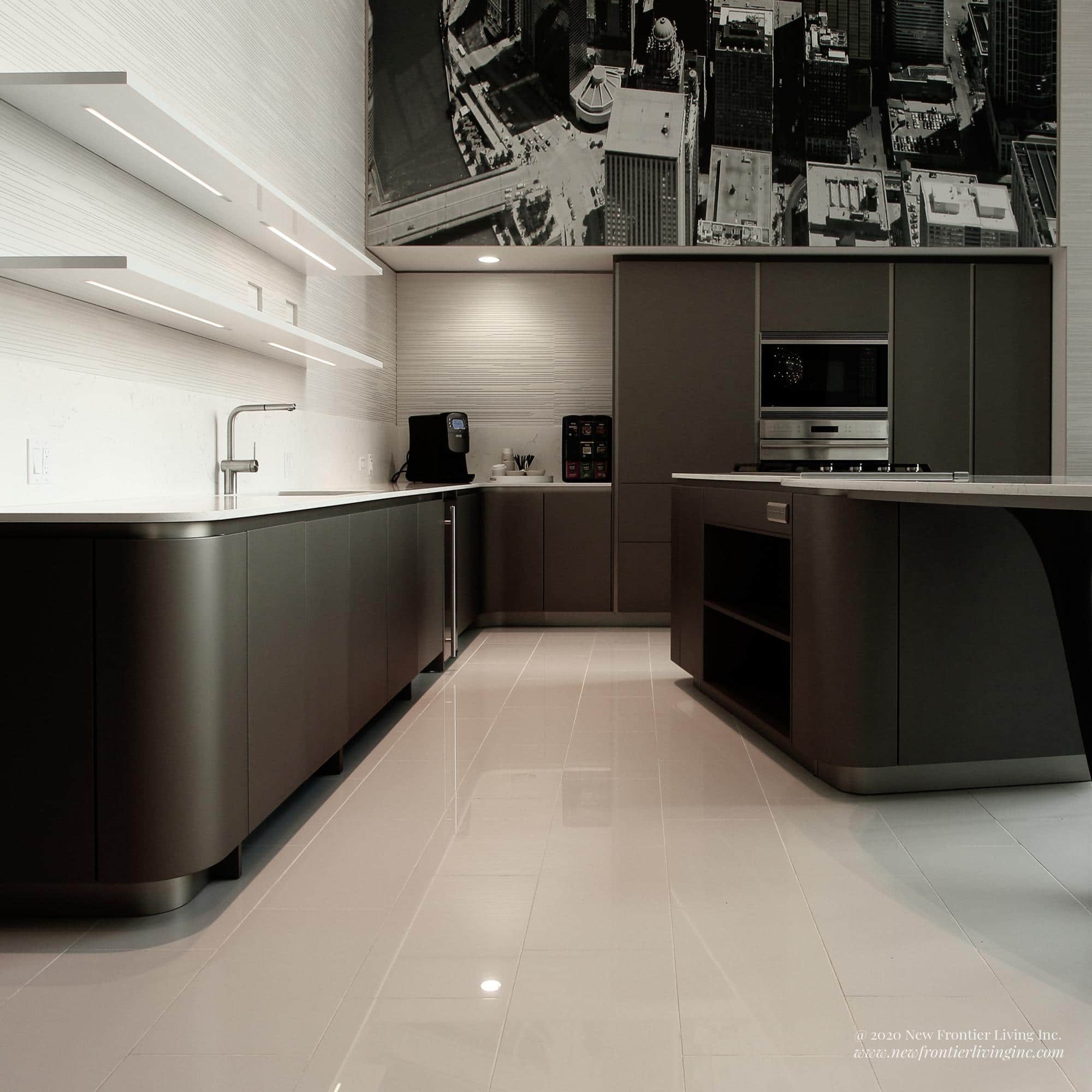 Black kitchen with white countertops and island, two long white shelves above the sink