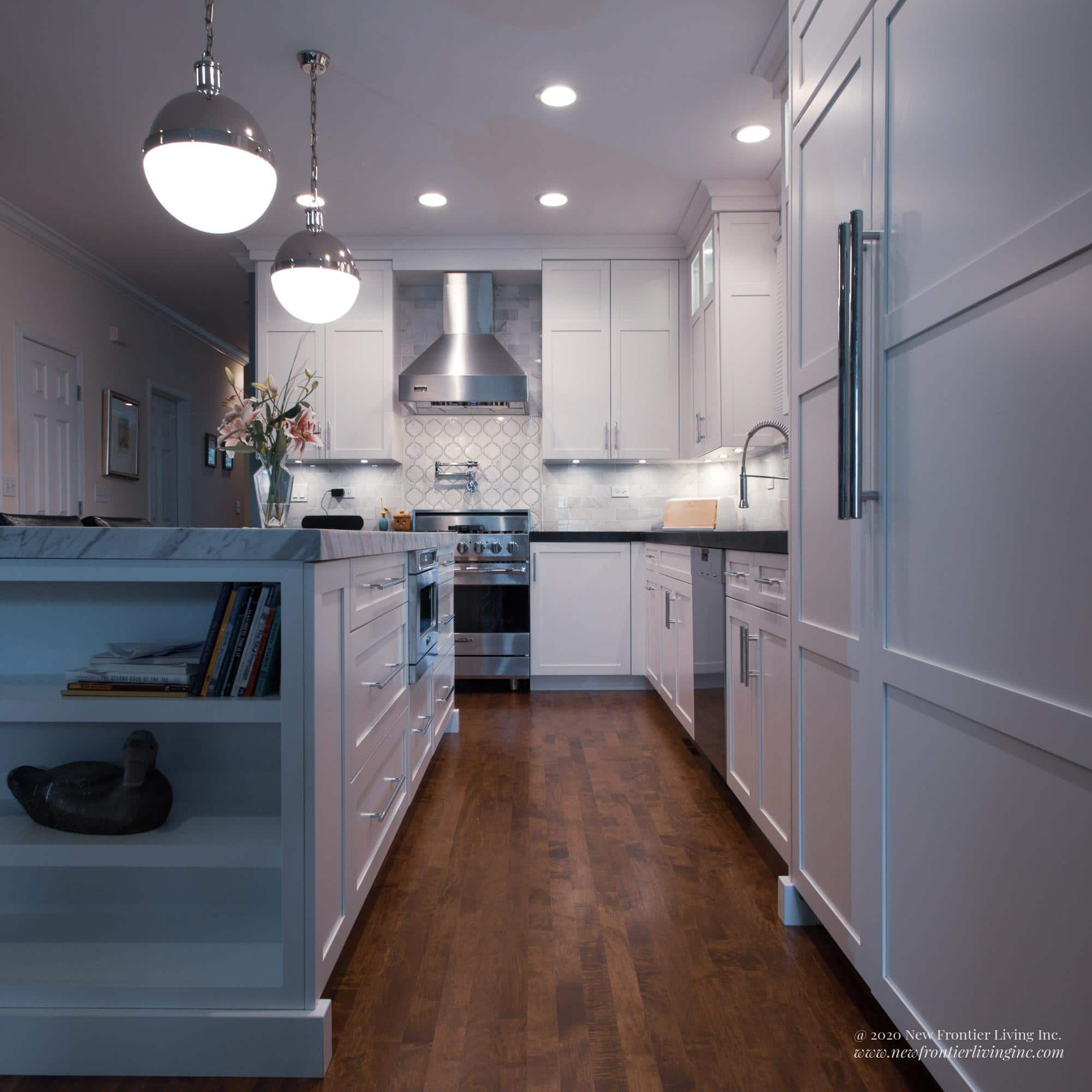 White plain and fancy kitchen with island and light gray countertop and long wall cabinets on the right