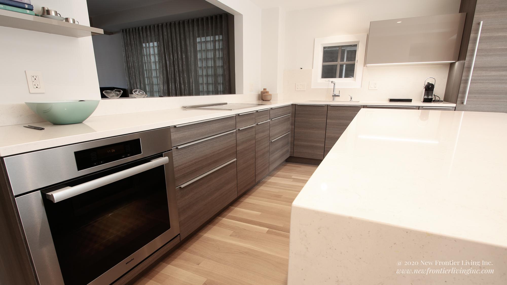 Dark brown kitchen cabinets and oven