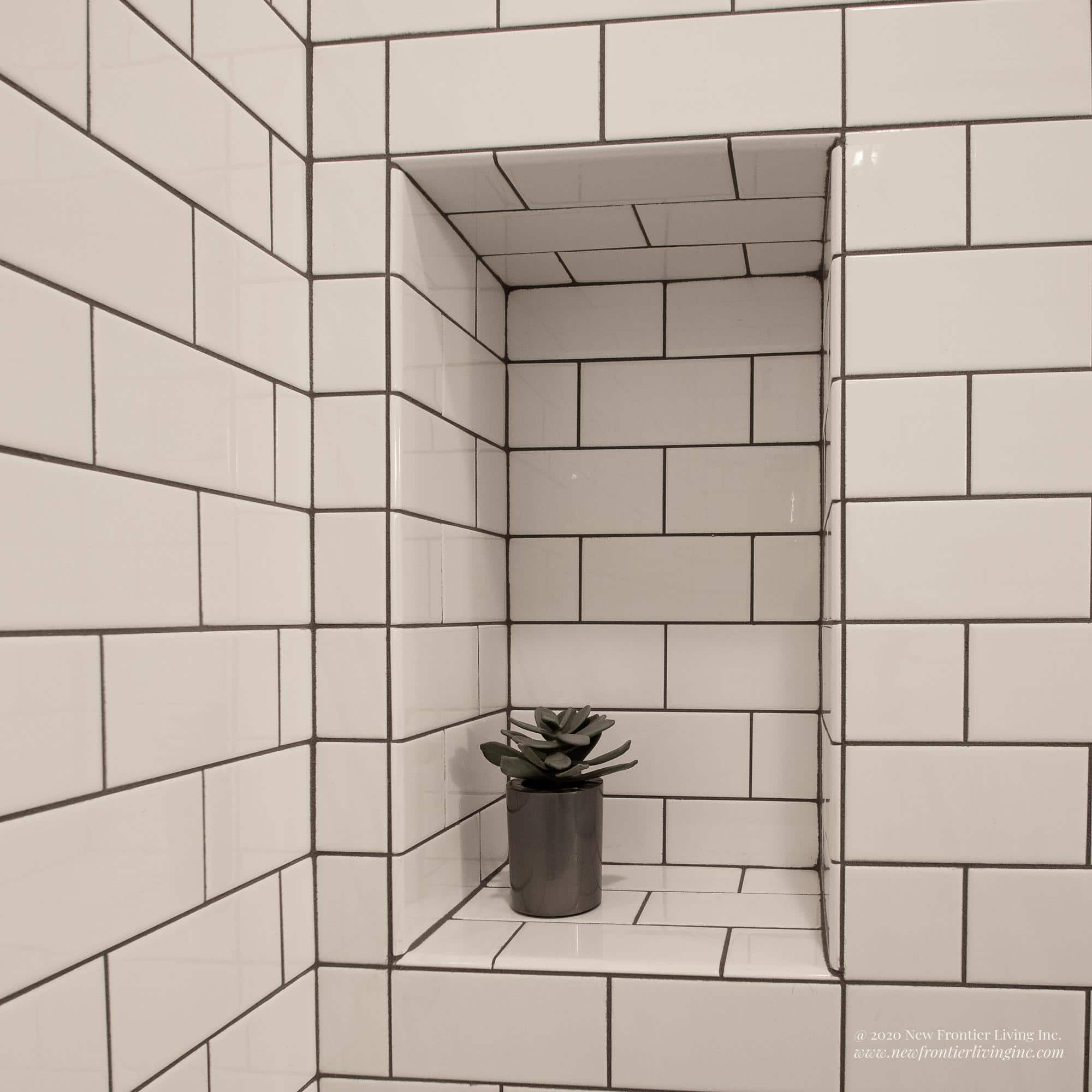 Traditional white ceramic bathroom built-in shelve in the wall with flower