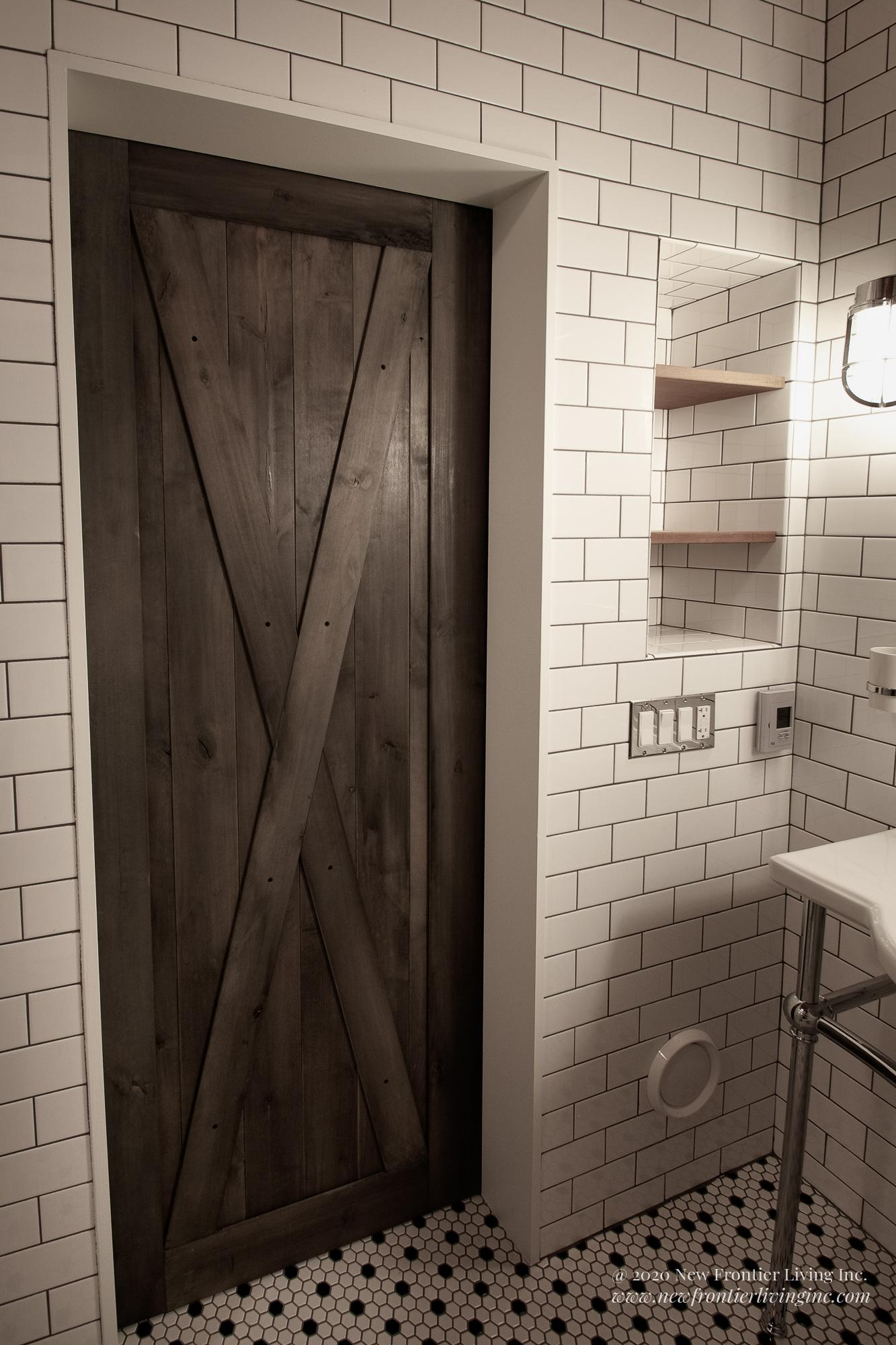 Traditional white ceramic bathroom with barn door entry