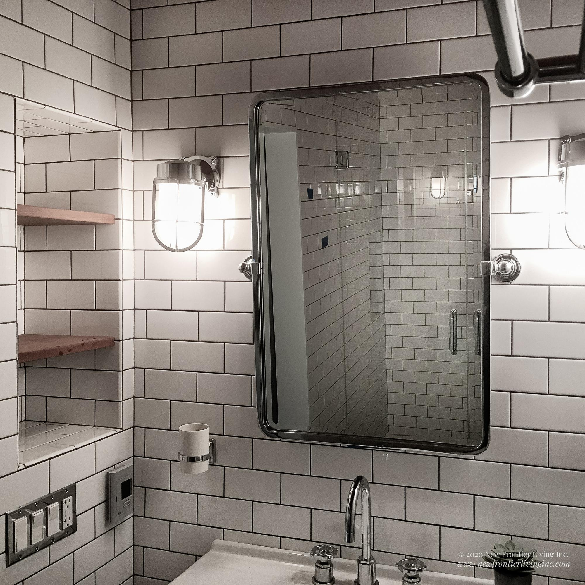 Traditional white ceramic bathroom mirror above sink close-up