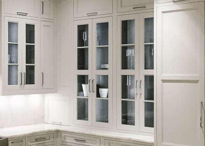 Tall traditional cream kitchen with upper glass cabinetry and cream floor