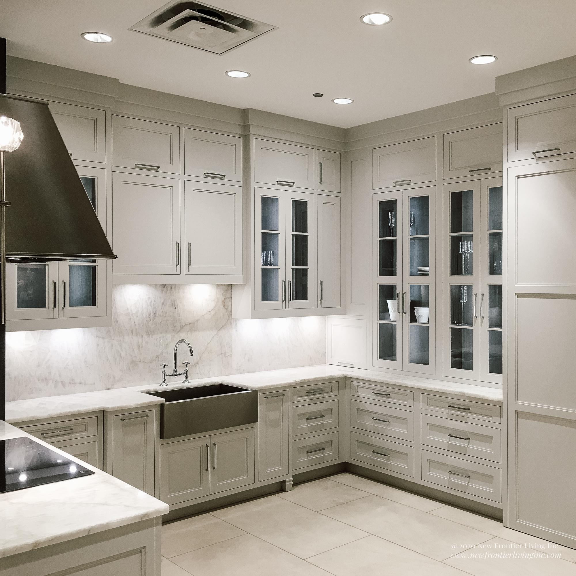 C-shaped traditional cream kitchen with glass upper cabinetry