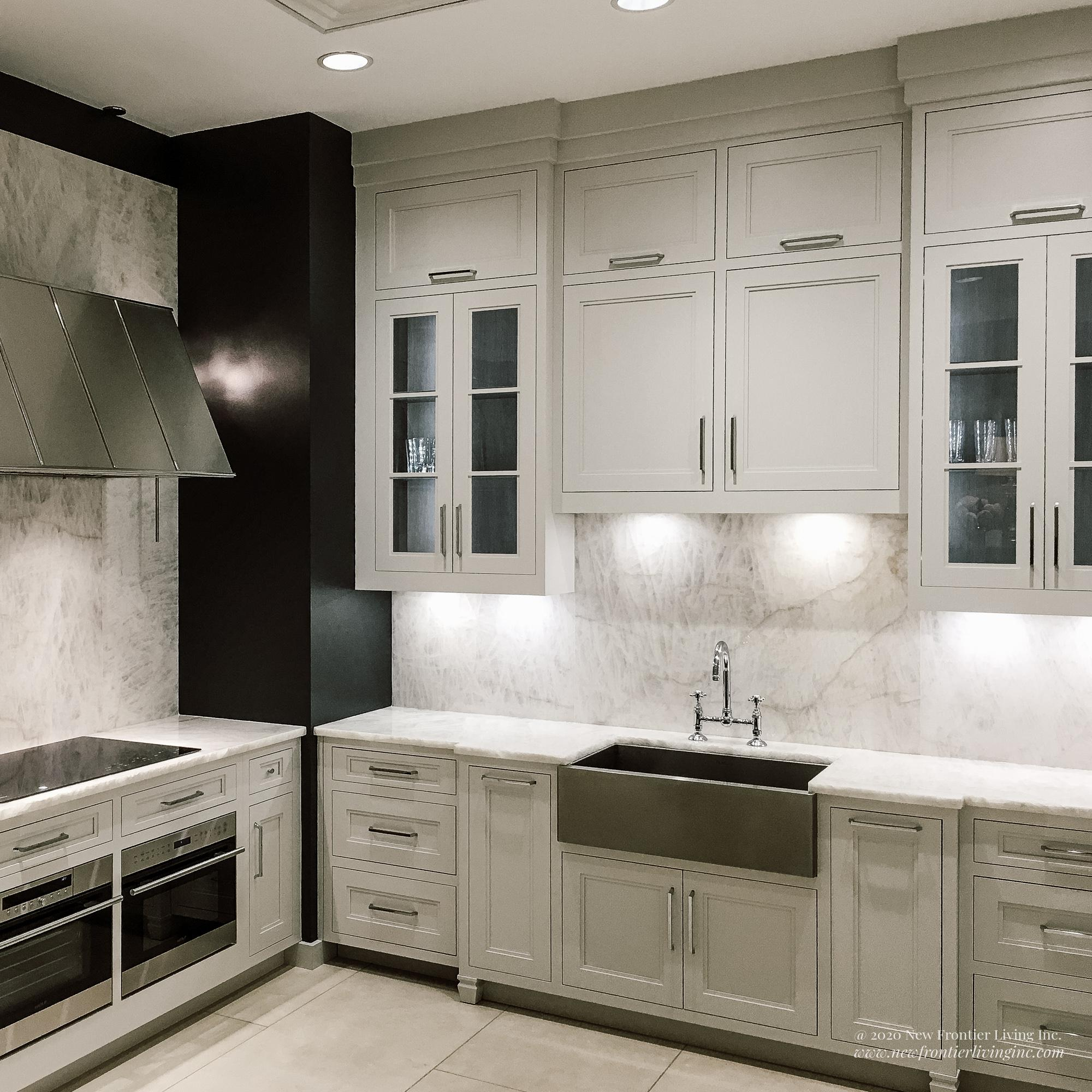 C-shaped traditional cream kitchen with upper glass cabinetry and cream floor