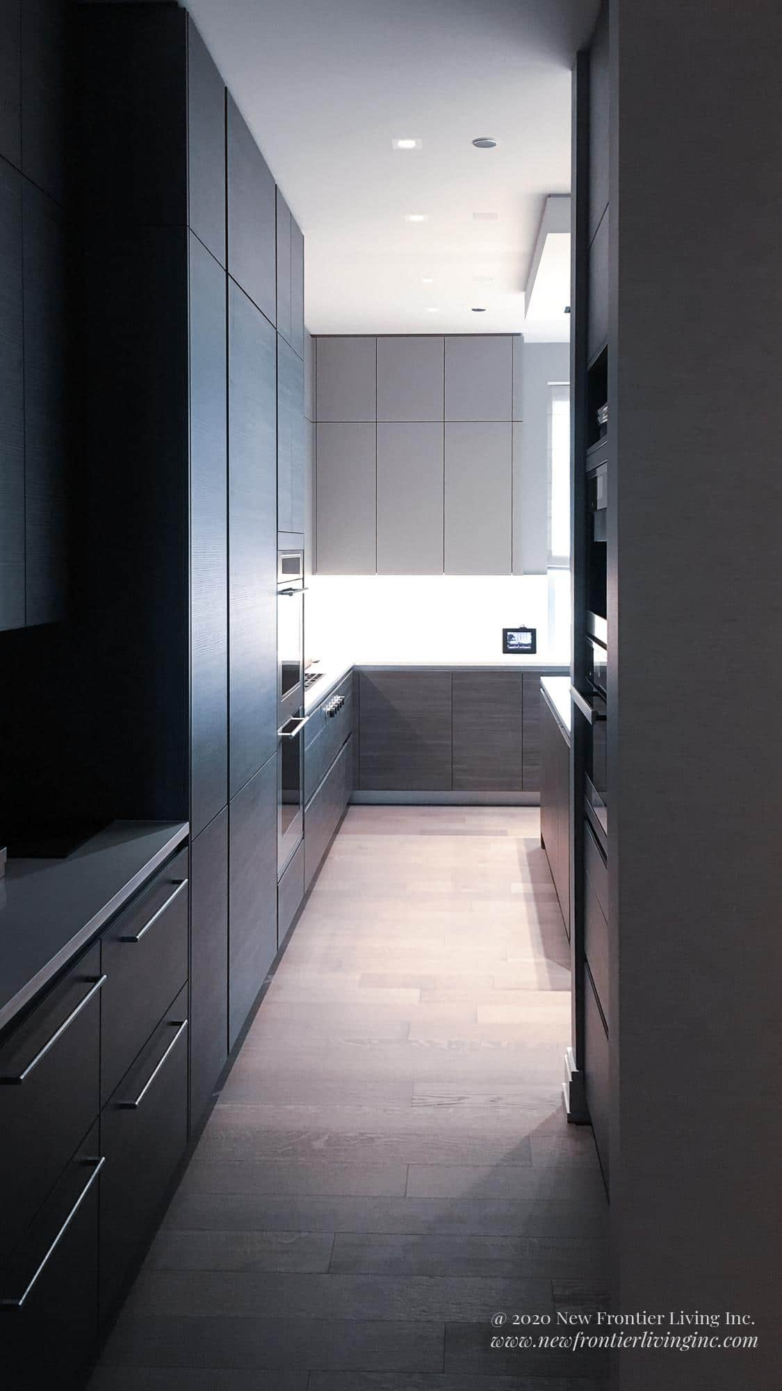 Black kitchen bottom cabinetry with and without handles with wooden floor
