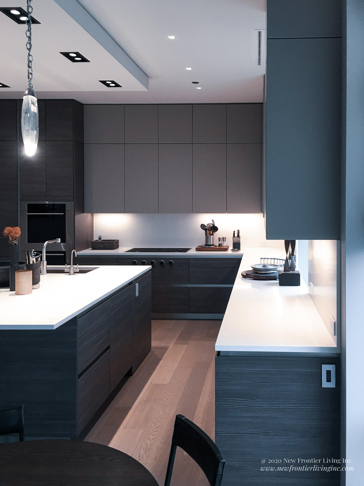 Black kitchen cabinetry and white countertop