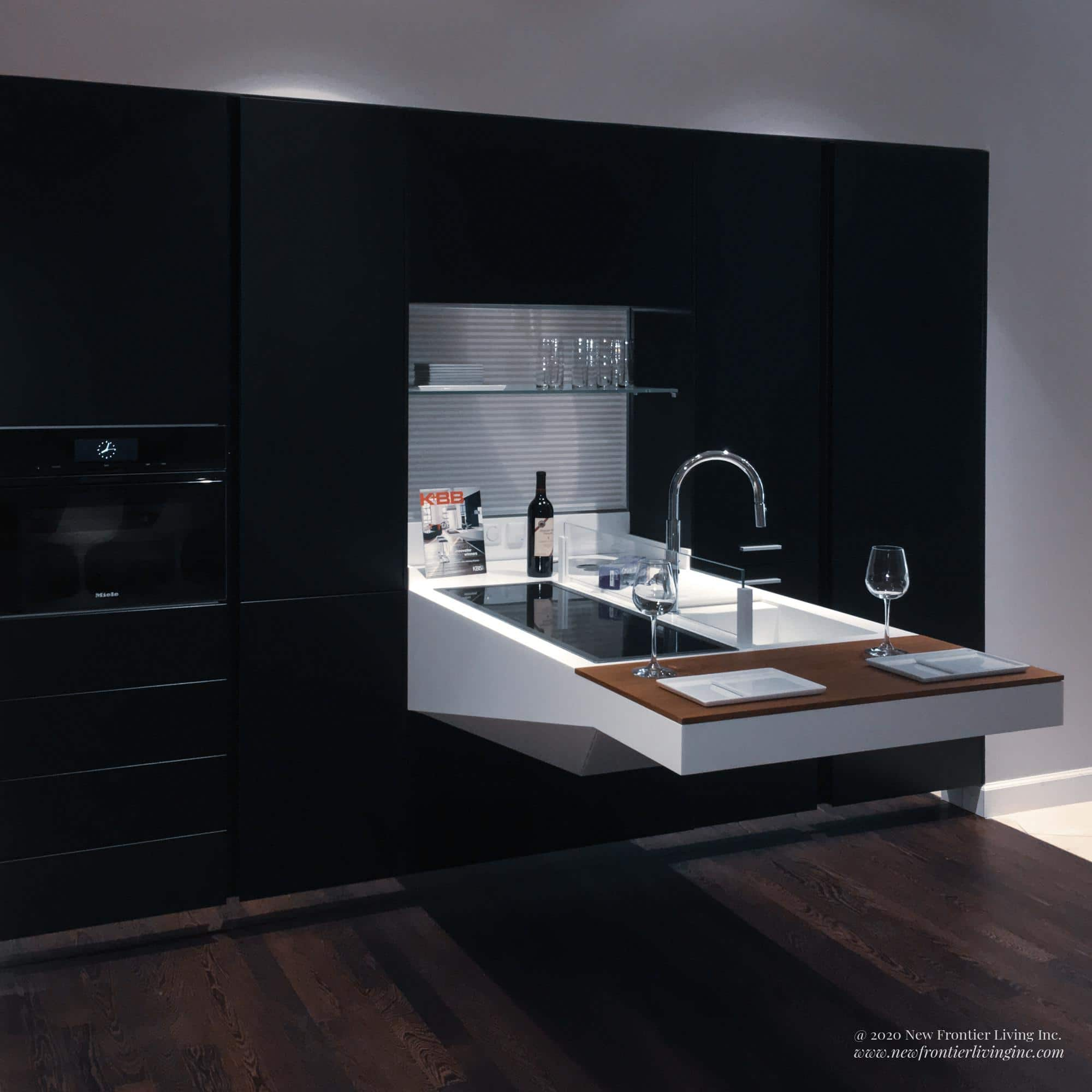 Black kitchen cabinetry and white foldable countertop