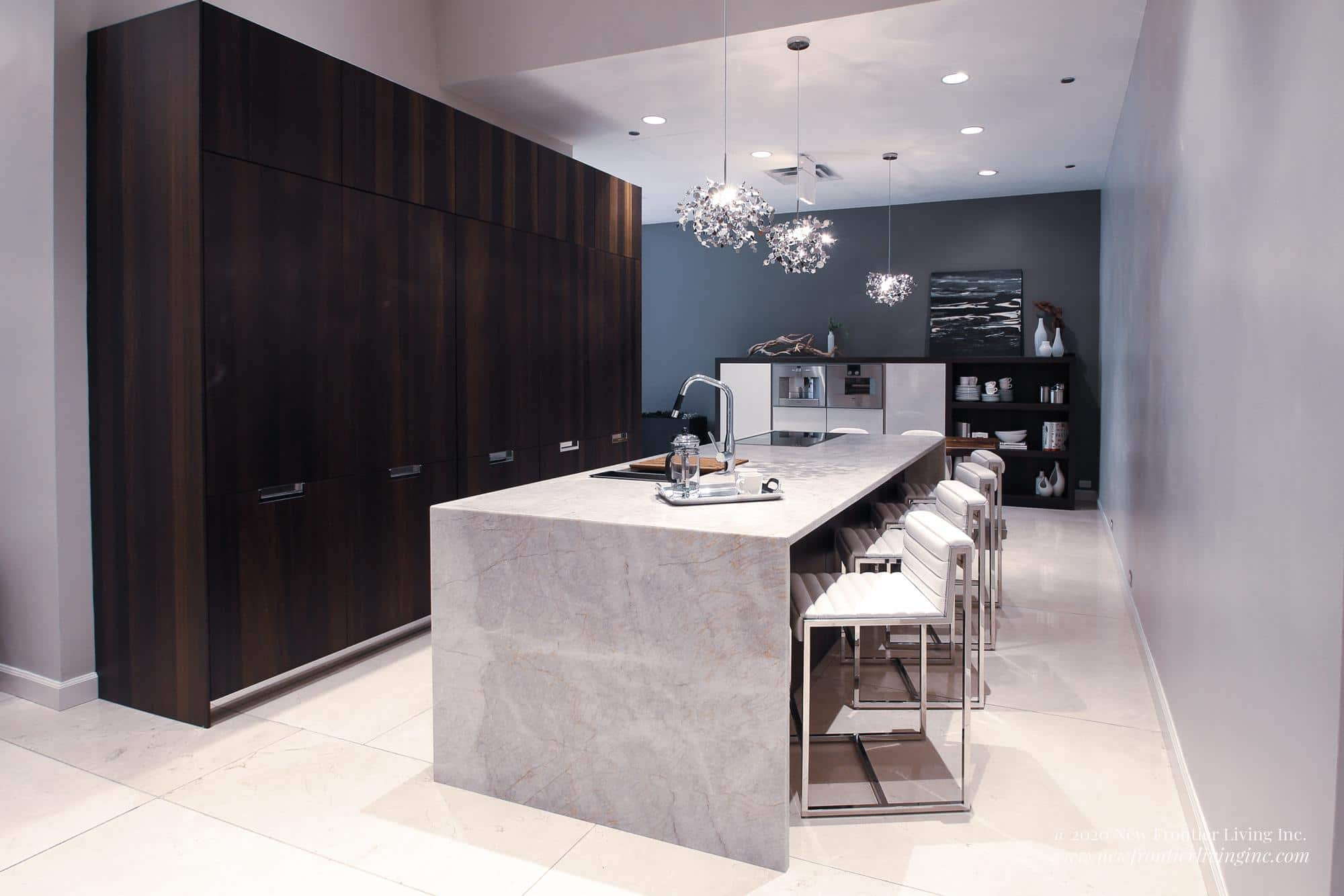 Black kitchen with a cream waterfall island and four stools