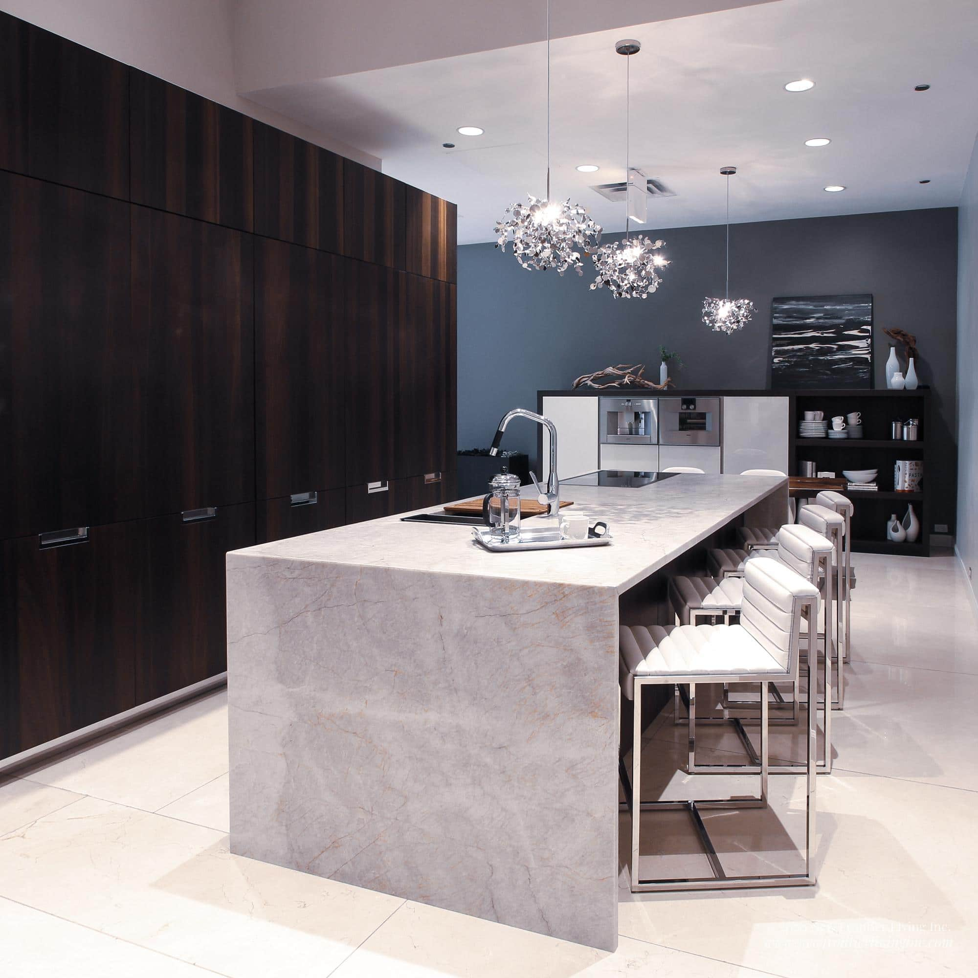 Black and cream kitchen with cream waterfall island