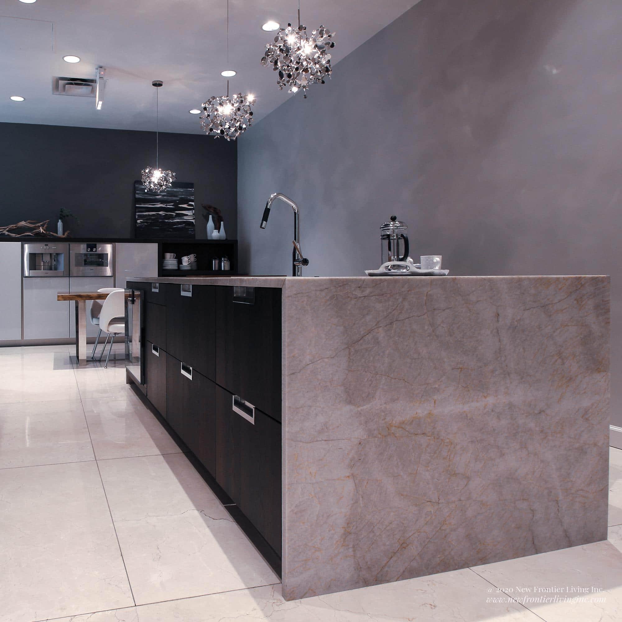 Cream kitchen waterfall island with black cabinets