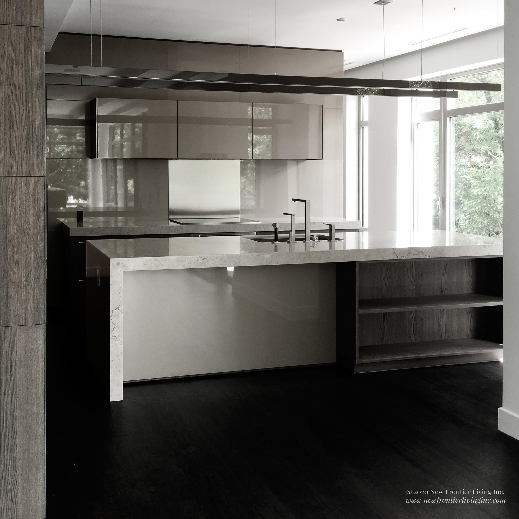 Gray and white waterfall kitchen island with modern sinks and wall cabinetry