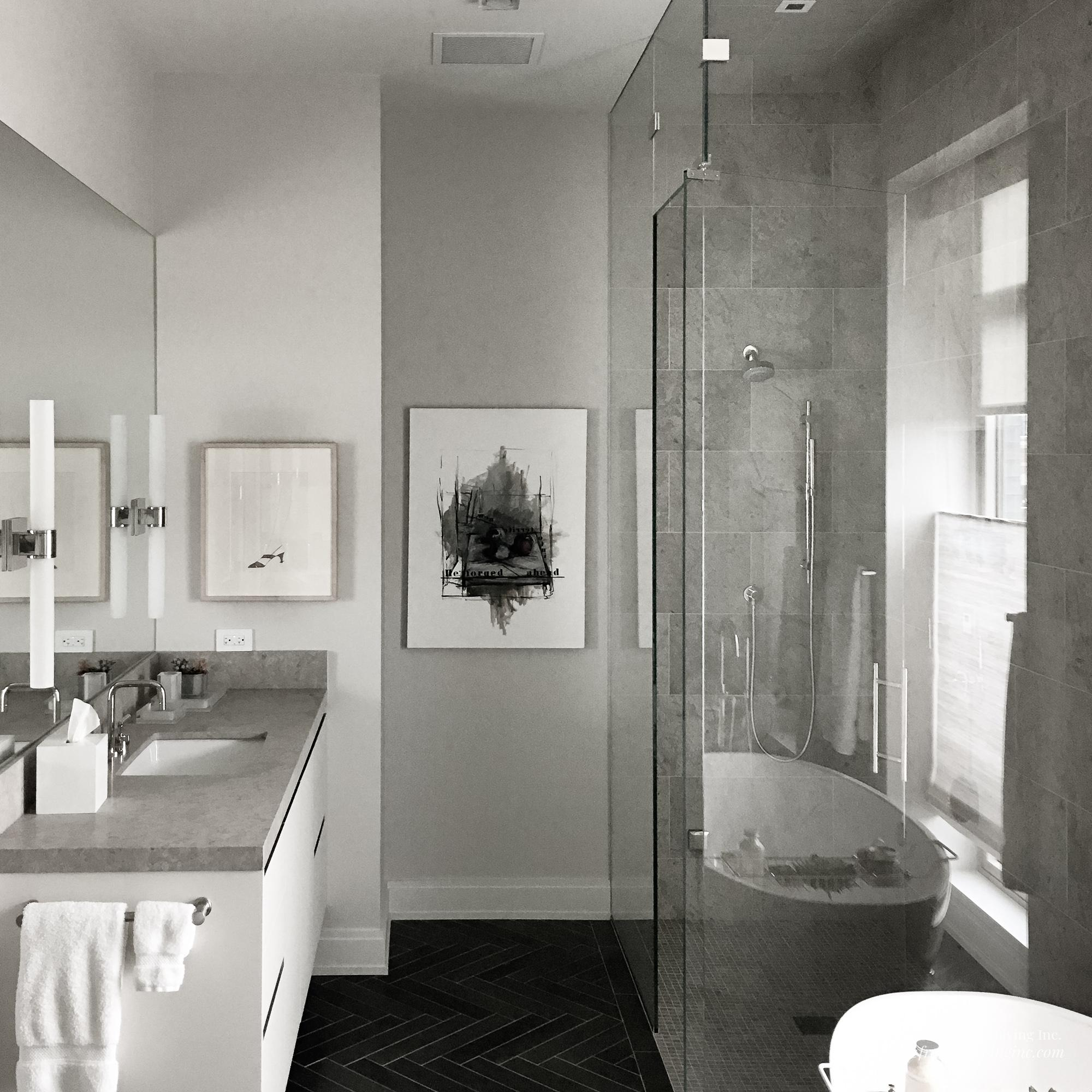 White bathroom with gray counters, walk-in shower and tub on the right, single sink