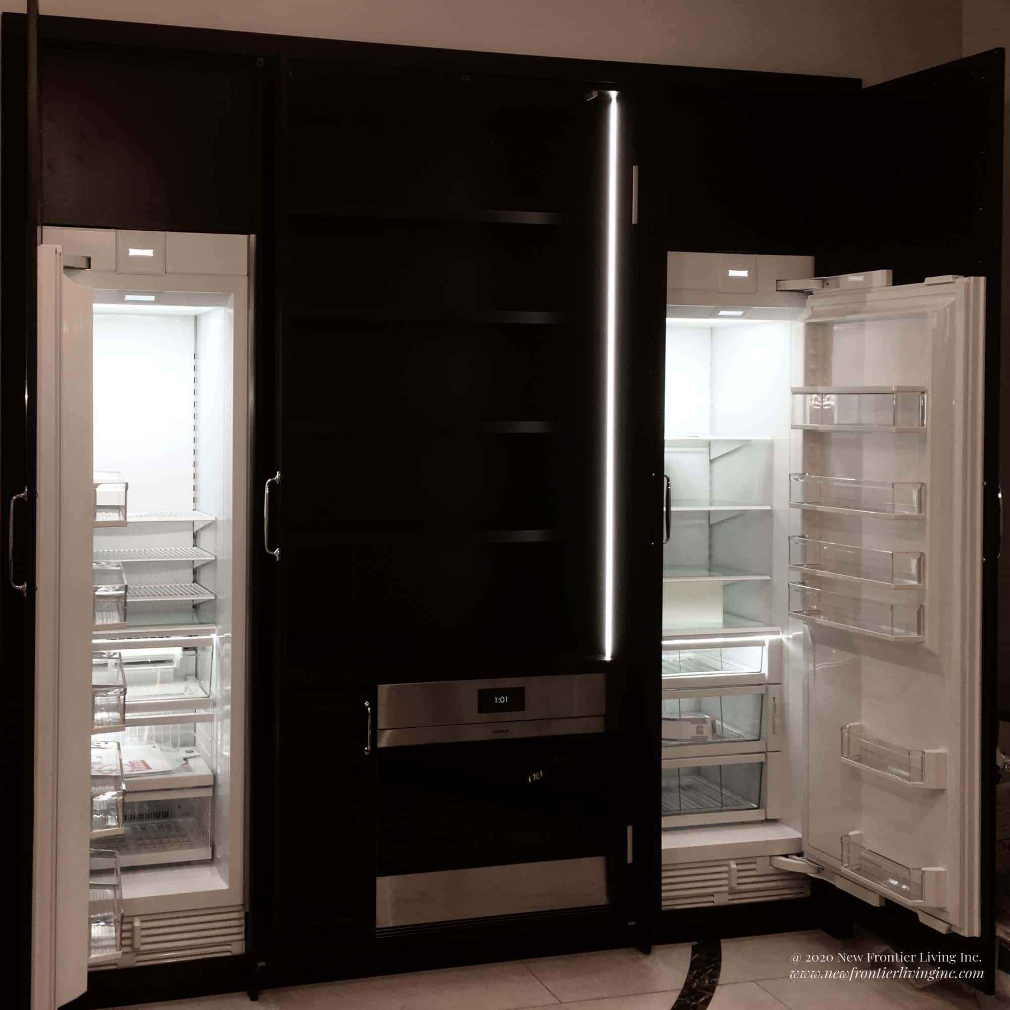 Black kitchen cabinet panelling for fridge and freezer