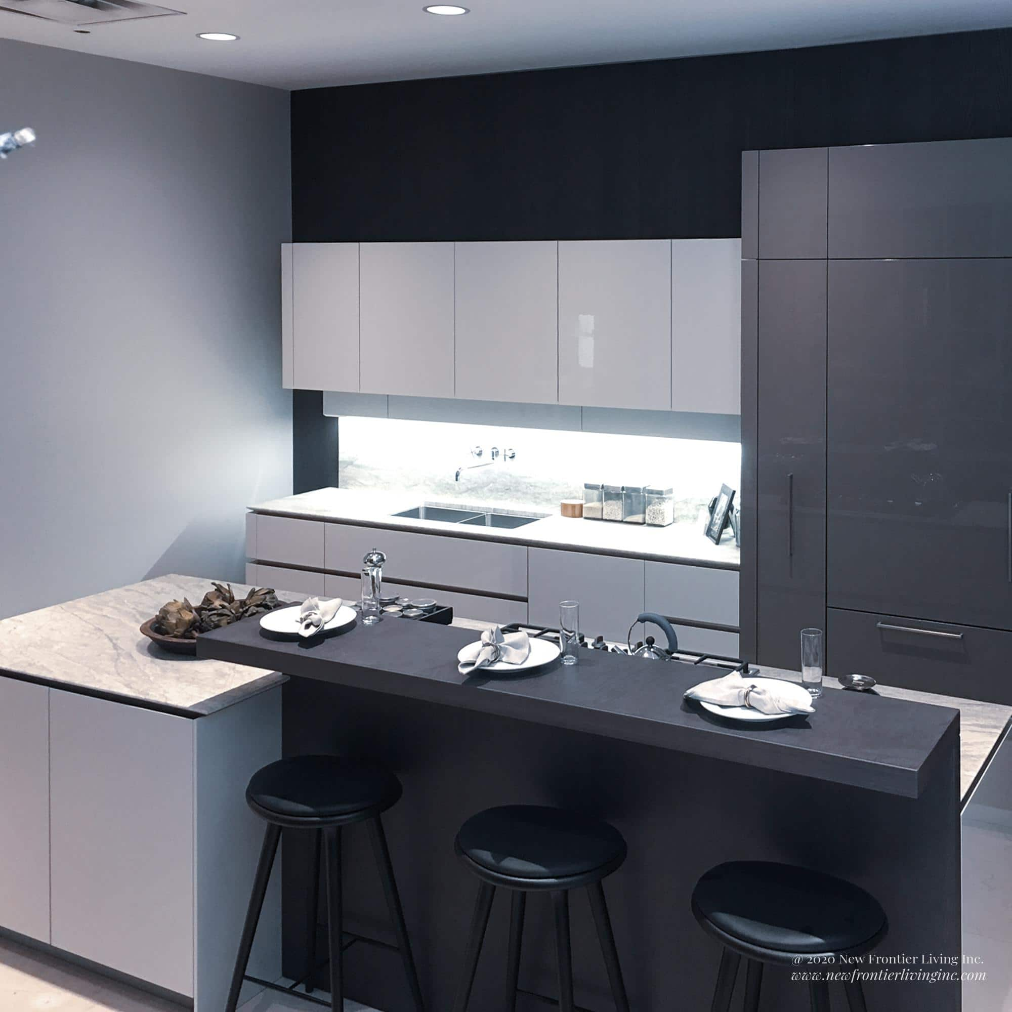 Alternative black and white kitchen and two islands, plates set on the black island
