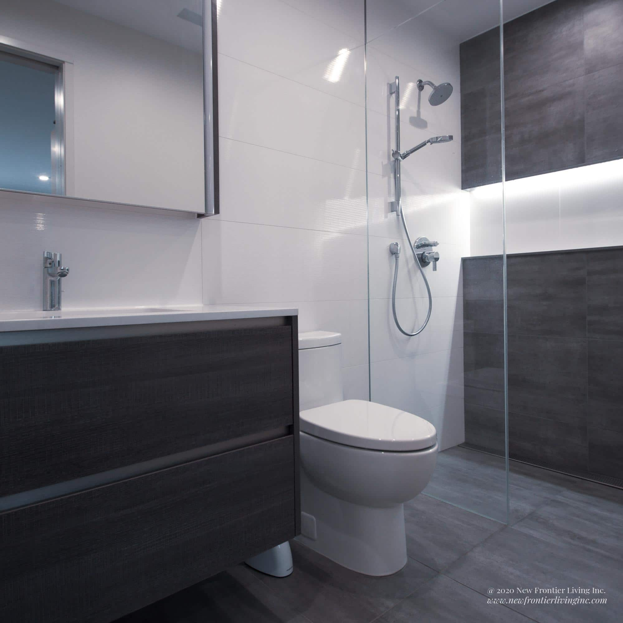 Gray vanity and tiles bathroom with white countertop and backsplash and a niche for bathroom essentials in the shower