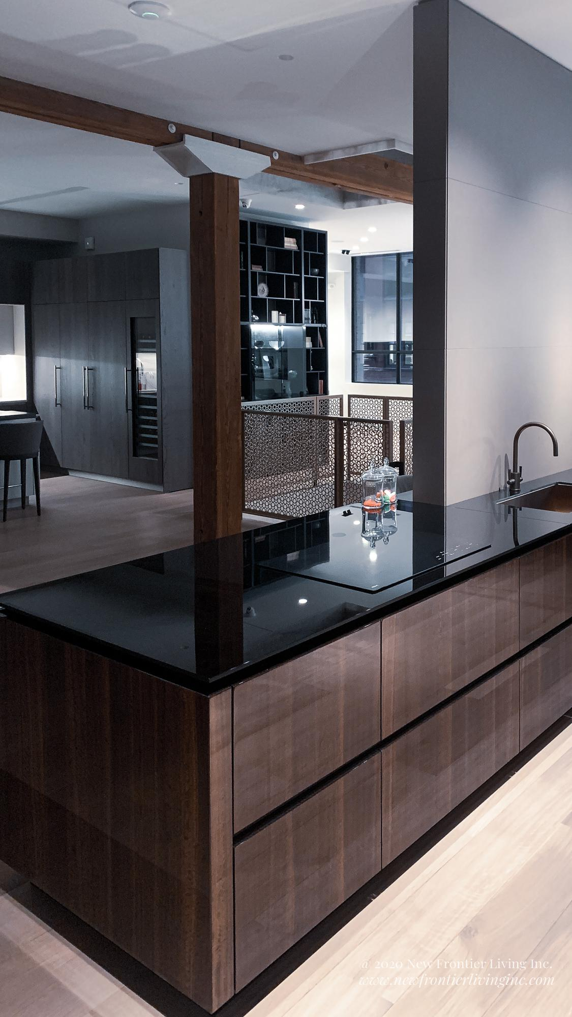 Black and Brown glossy kitchen with black countertop, no handle drawers