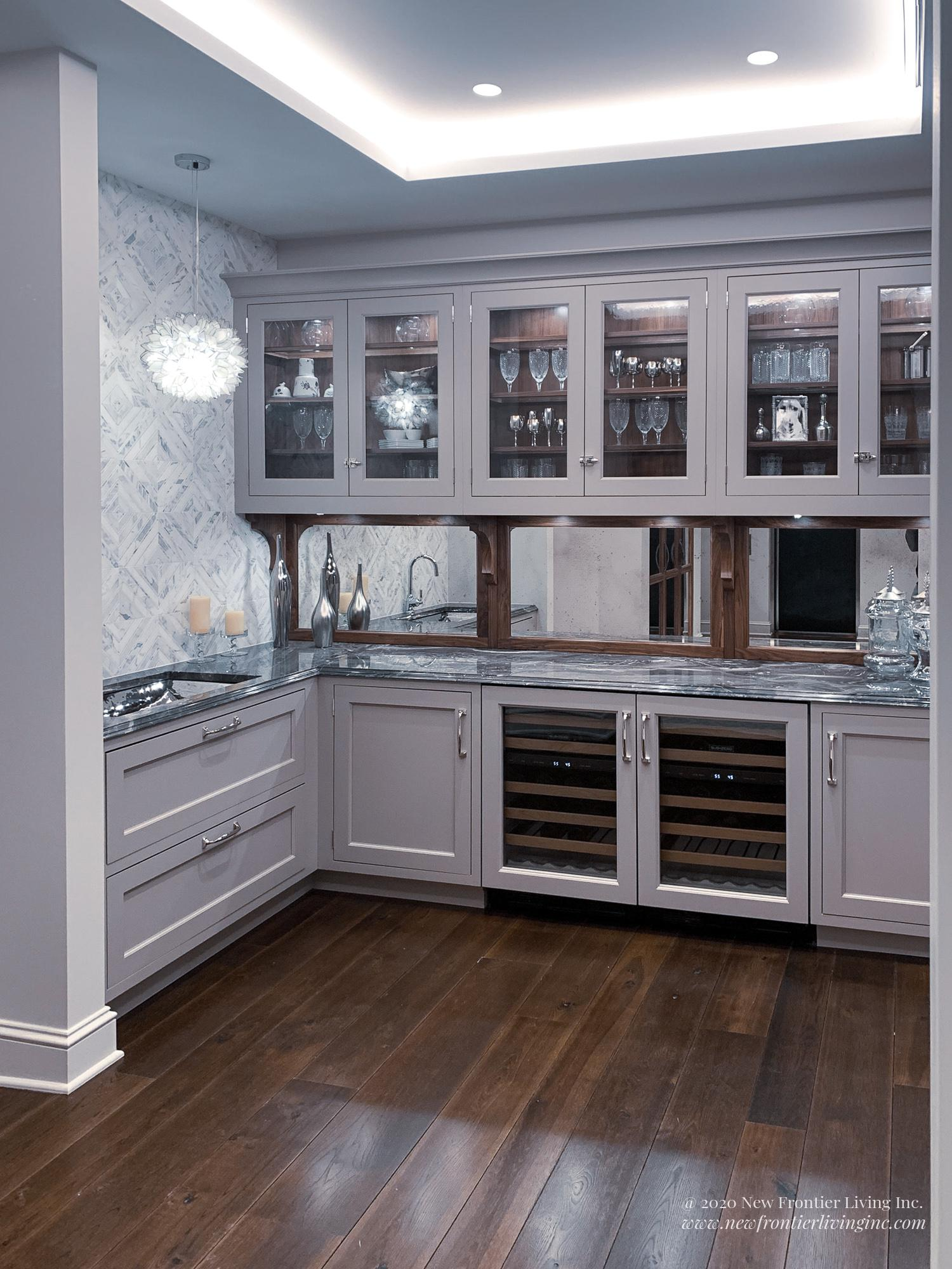 Lavender traditional kitchen cabinetry and upper glass cabinets, wine coolers on the bottom