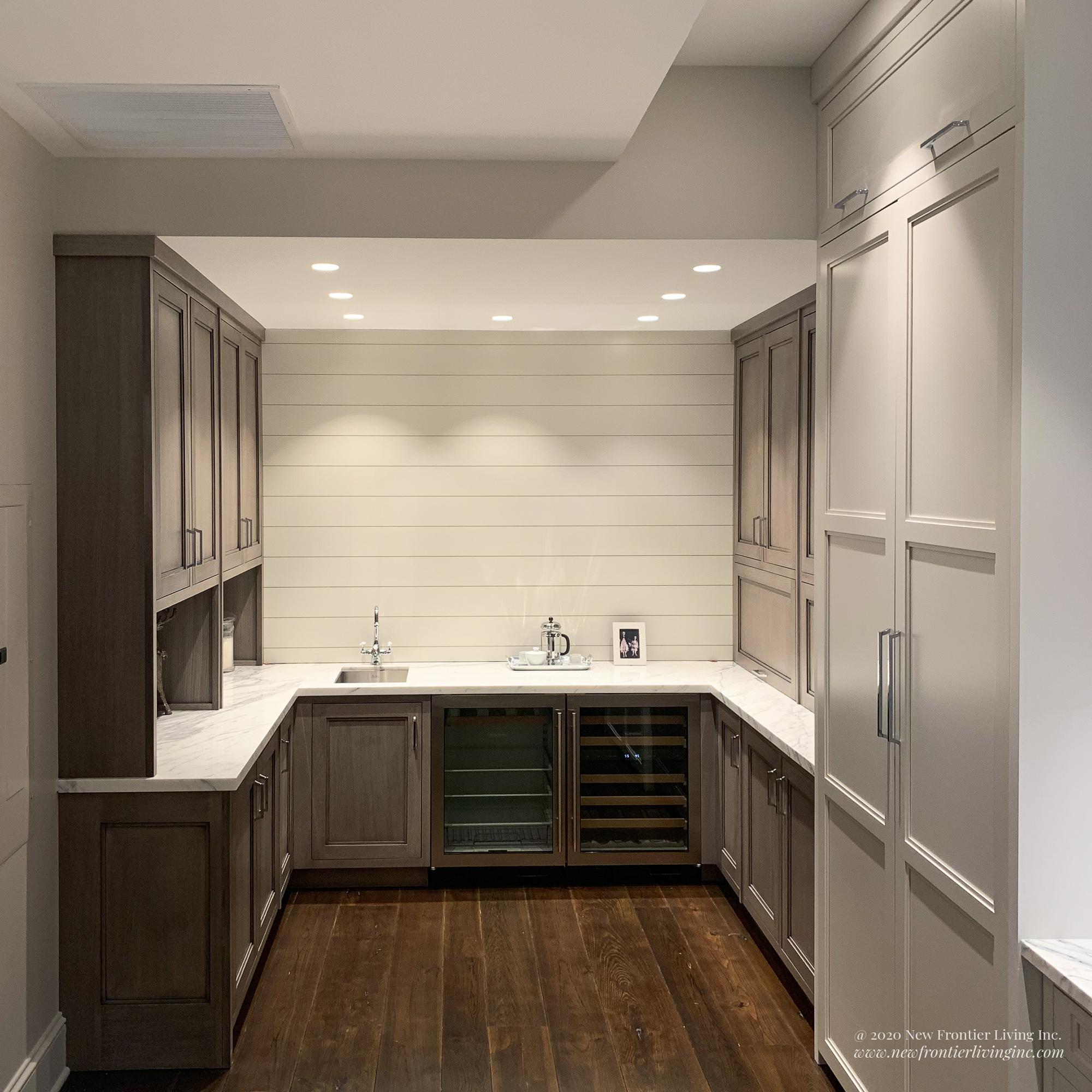 Long shot of Matte finish traditional peach kitchen cabinetry  with white countertop