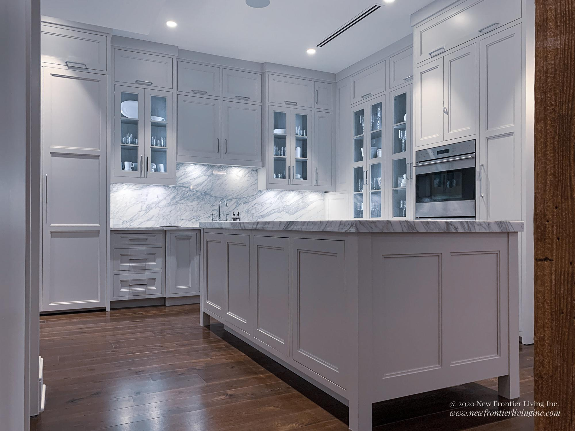 Pure white kitchen island from the back and low angle