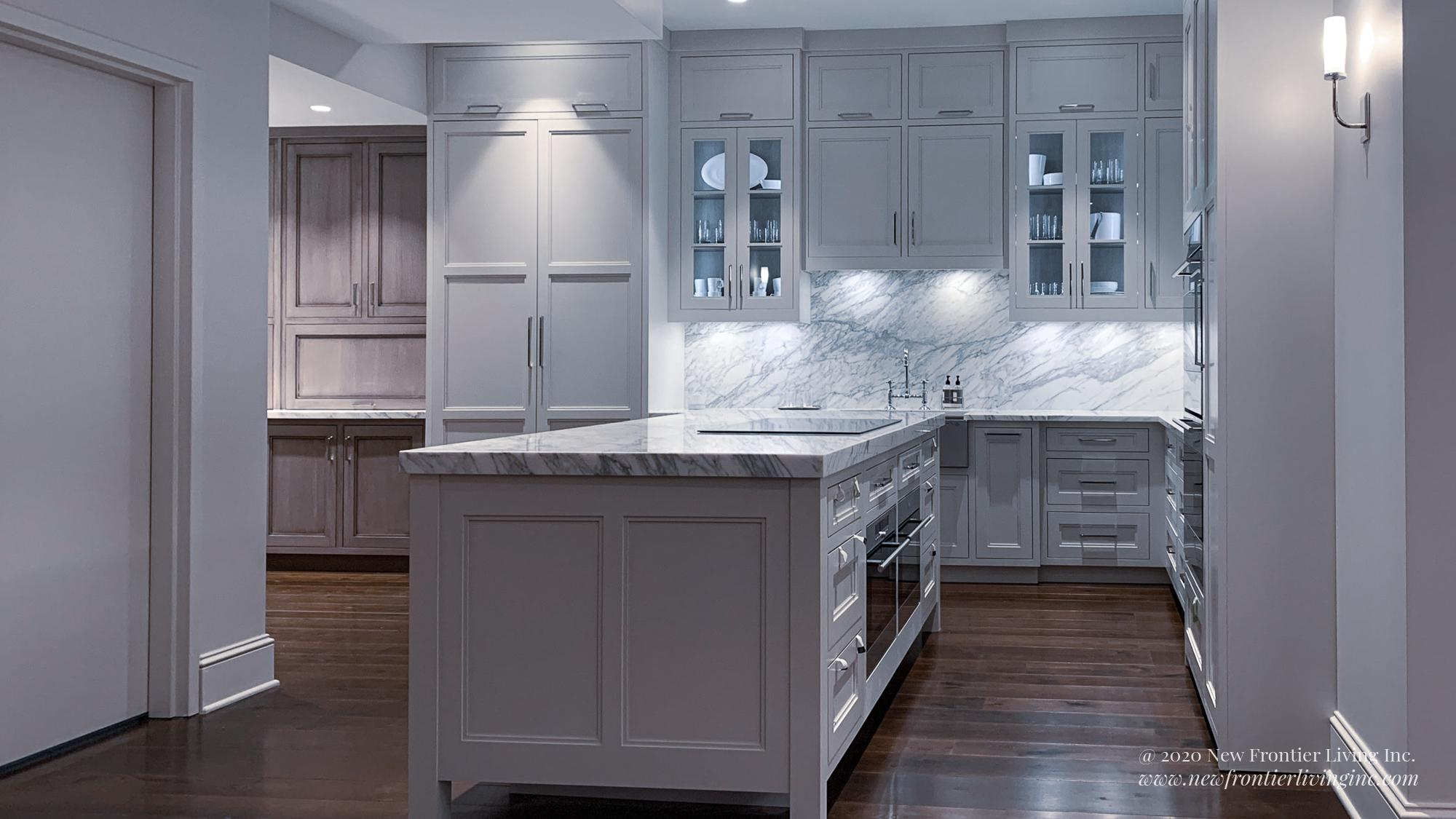 Pure white kitchen cabinetry and an island with semi-glass upper cabinets