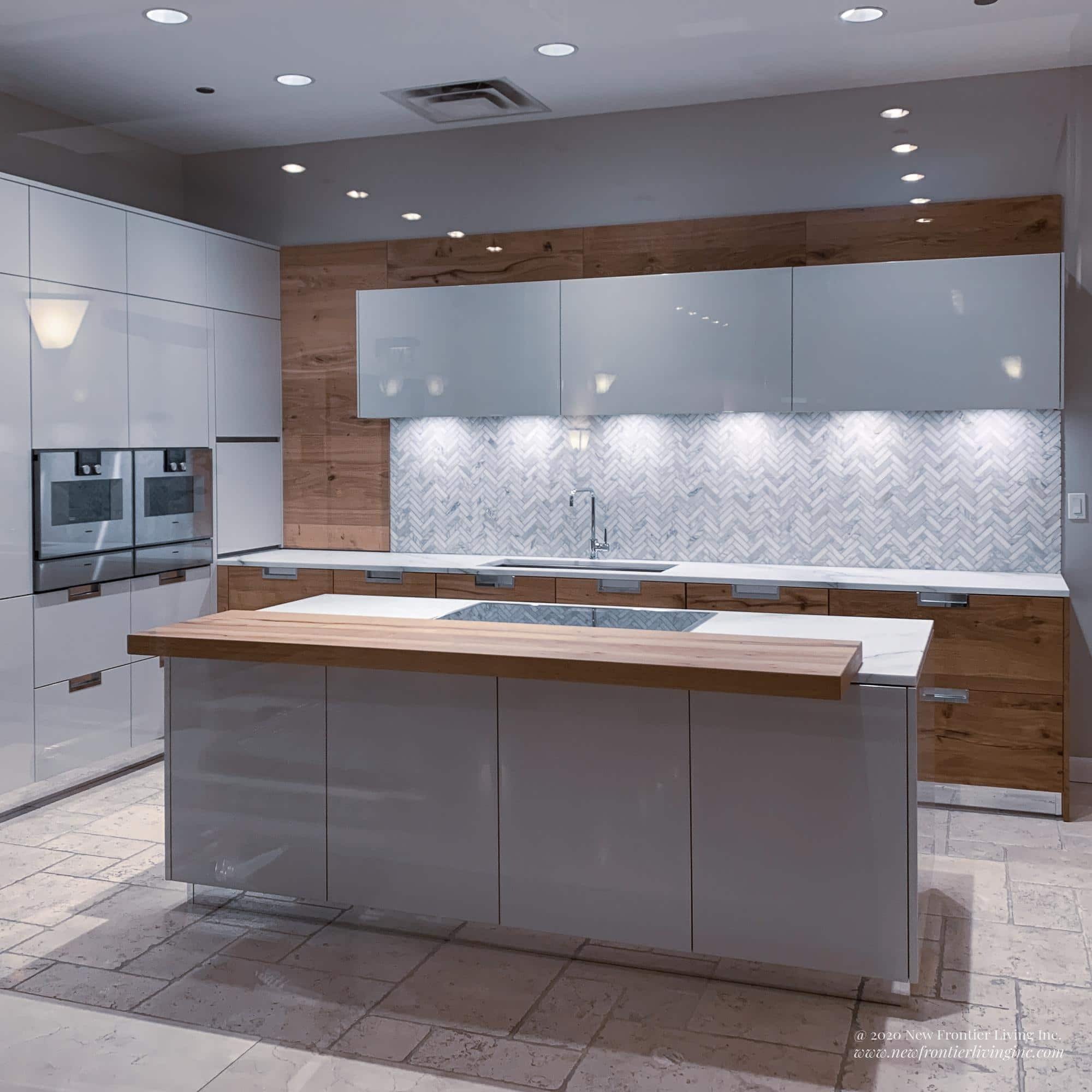 White and wood Snaidero kitchen with an island and white/wood paneling
