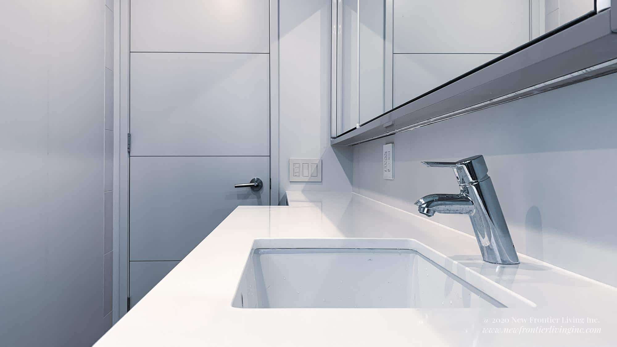 White counter in the bathroom with a single sink