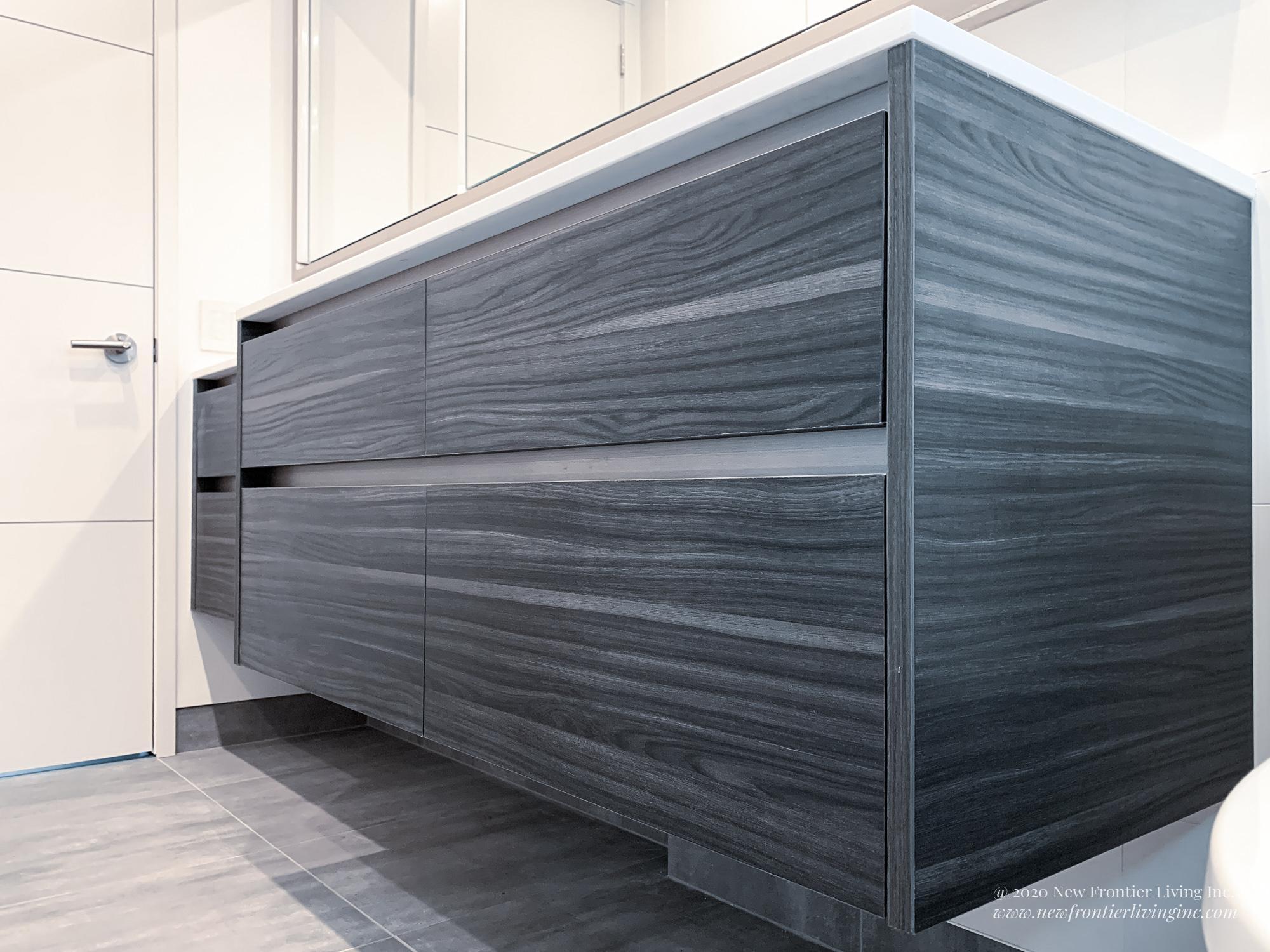 Close-up of dark gray bathroom vanity with white countertop