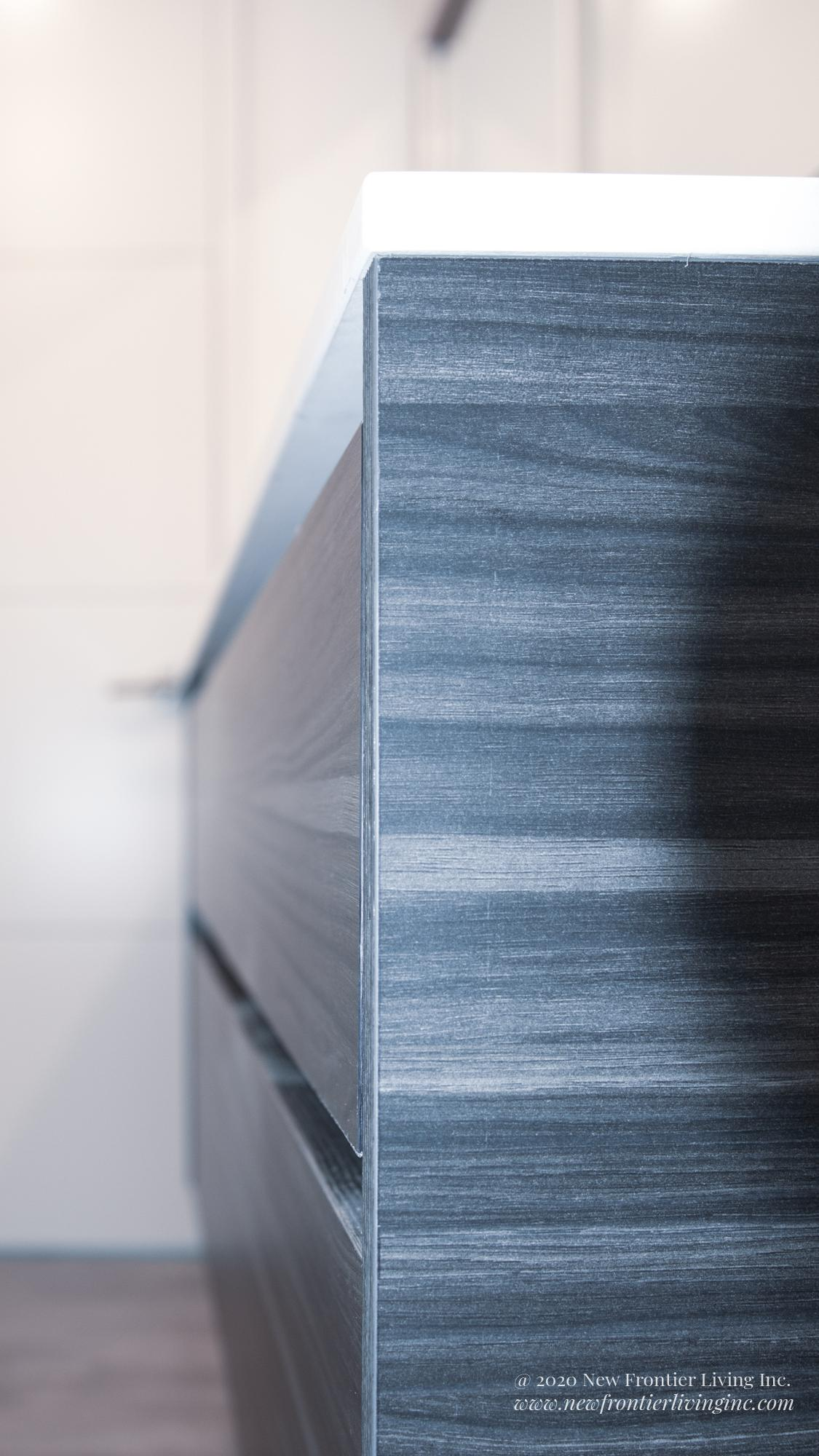 Close-up of dark gray textured paneling on cabinetry