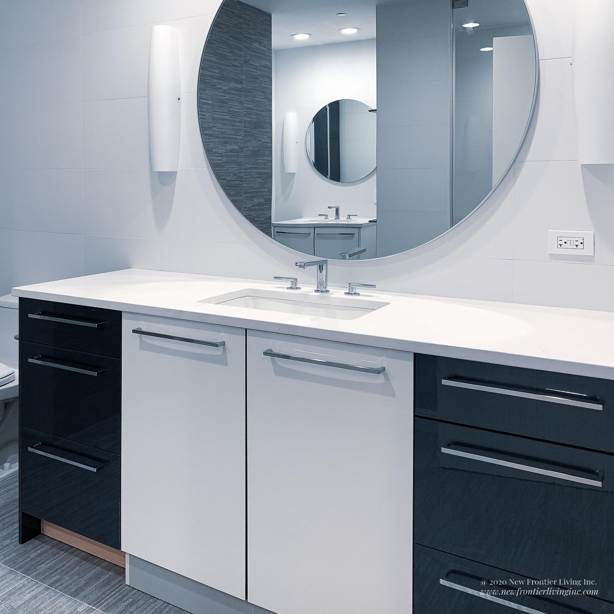 Blue and white bathroom vanity with one sink and mirror and another mirror reflected in a nook
