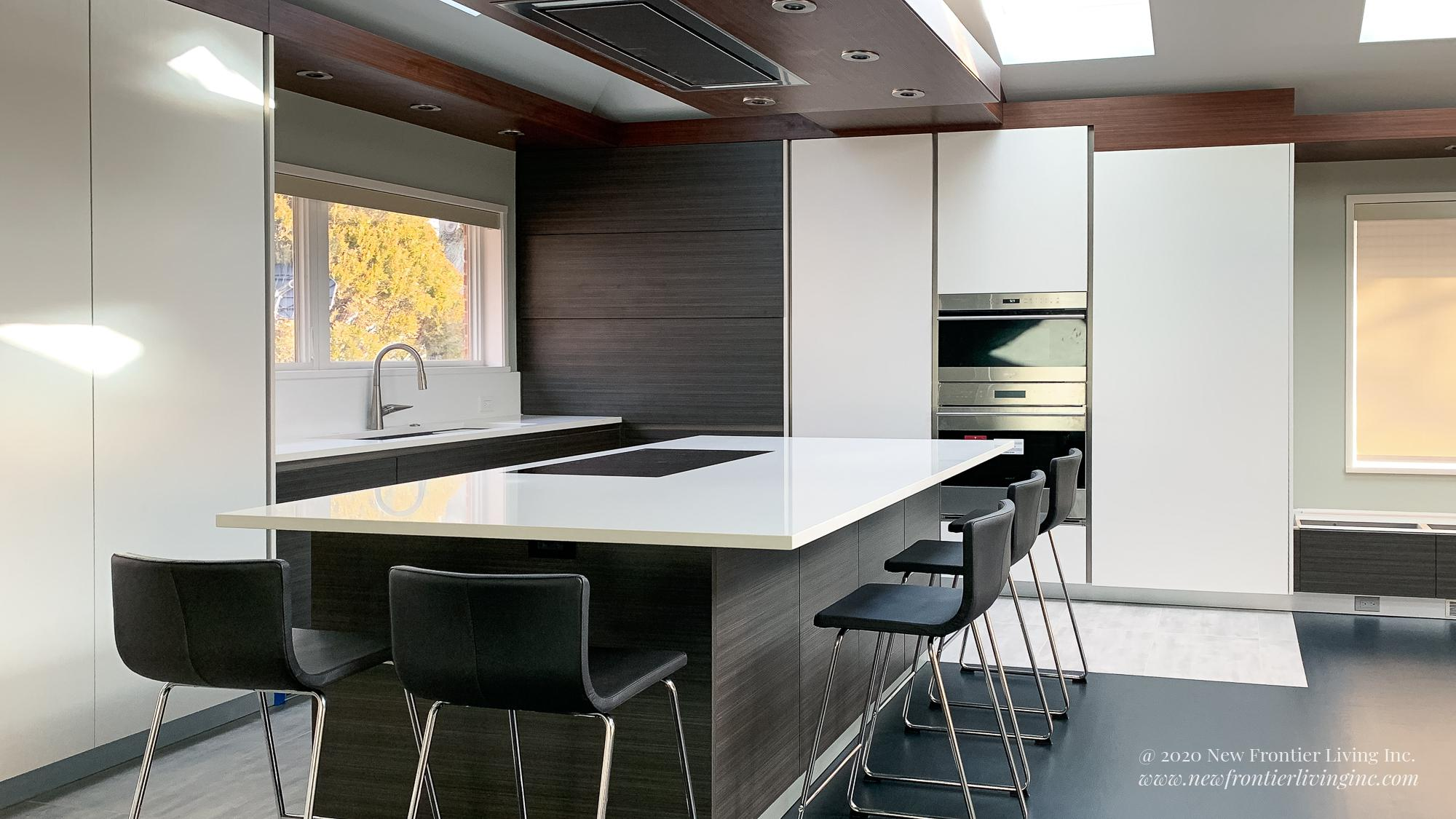 Dark gray and white kitchen with white quartz countertop on a kitchen island